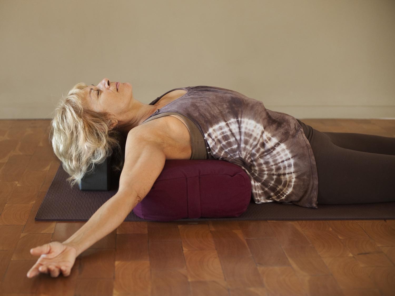 Woman On Yoga Bolster.jpg