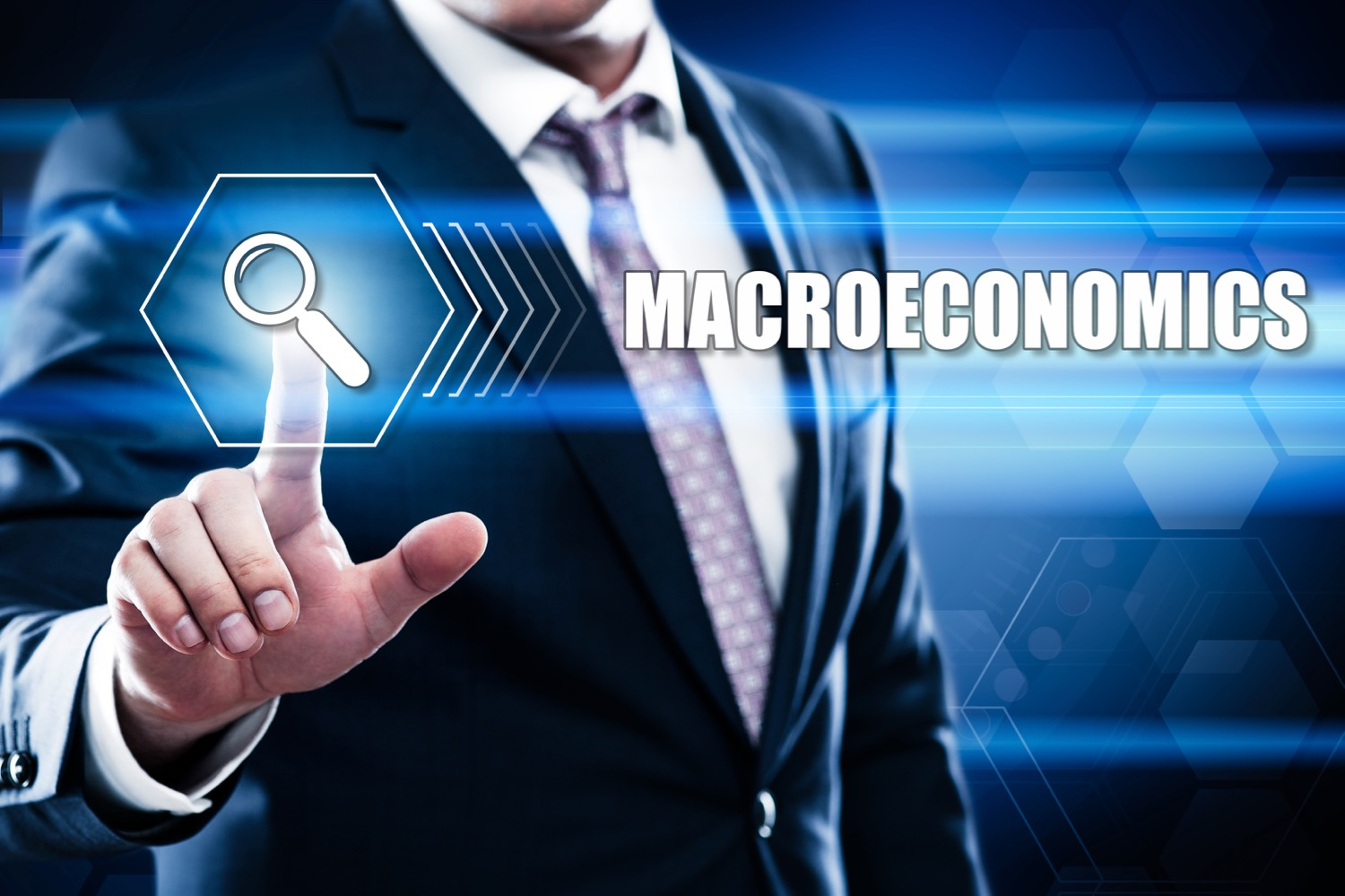 Business, technology, internet concept on hexagons and transparent honeycomb background. Businessman  pressing button on touch screen interface and select  macroeconomics.jpg