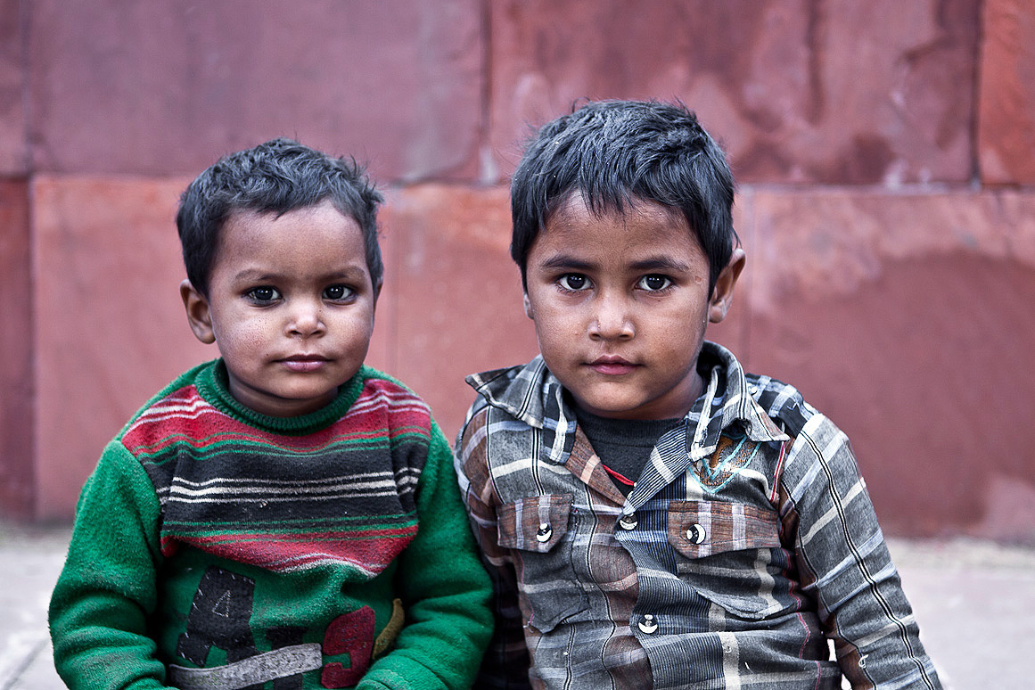 I photographed these children near Red Fort, Delhi. Both children took a break from playing near the main road leading to Red Fort. They have leprosy.