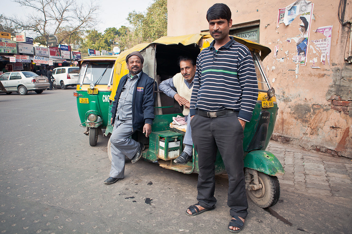 One of my favourtie moments. I was on my way back from India Gate via Khan Market and I saw these guys waiting for punters. I had to photograph them; they looked so suave, especially the man sitting in the rickshaw.