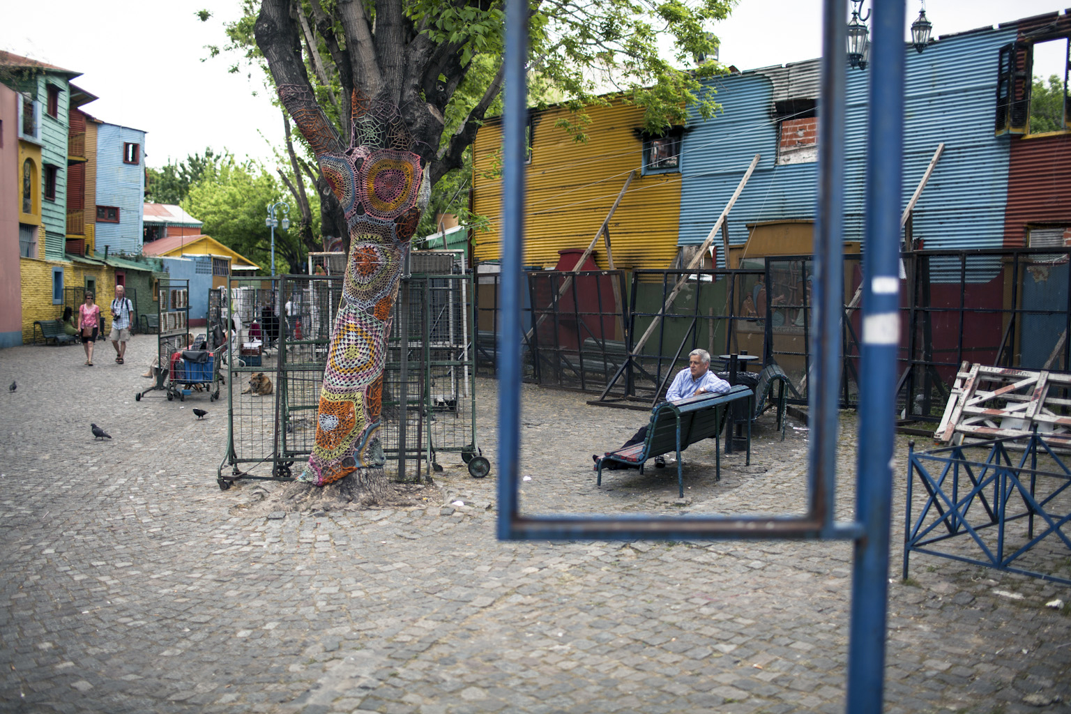 A man ponders on a bench in Caminito.