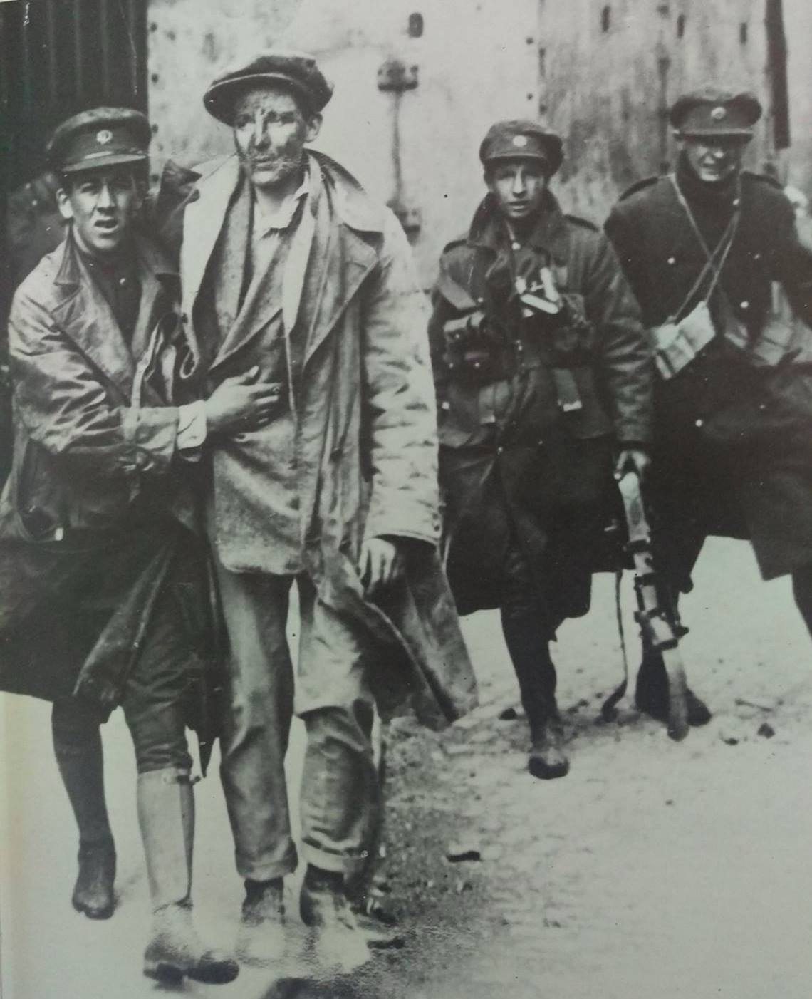 Joe being led away wounded from the Four Courts in 1922.