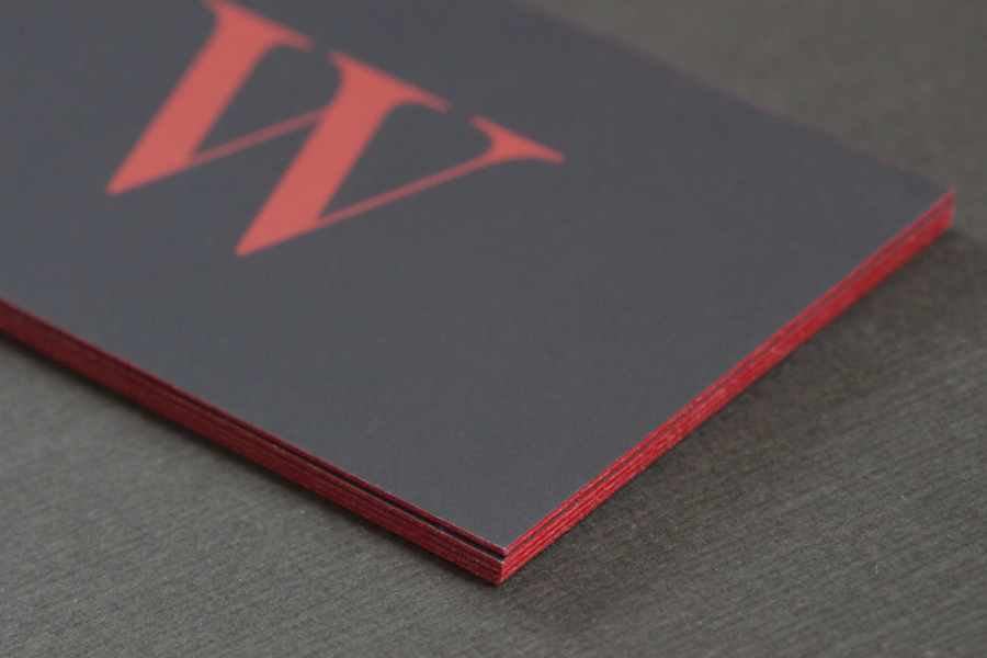 Close-up of red painted edges on a business card.