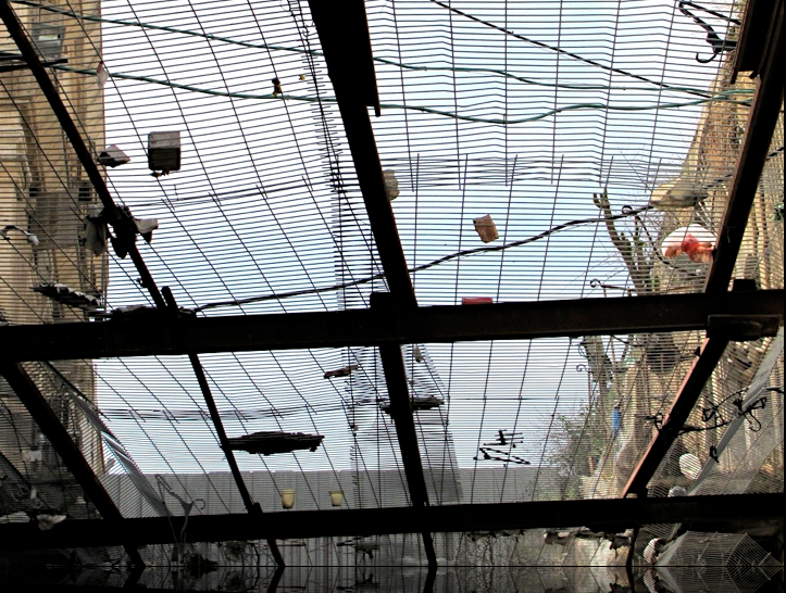 Mesh protecting street in hebron from items thrown down by israeli settlers living above