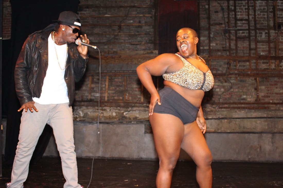 Pole Dancing Competition. Vocalist: King Aswad; Photographer: Trevor Brown