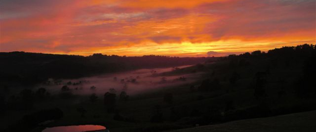 A magical sunrise lights up the low lying fog through the eastern valley