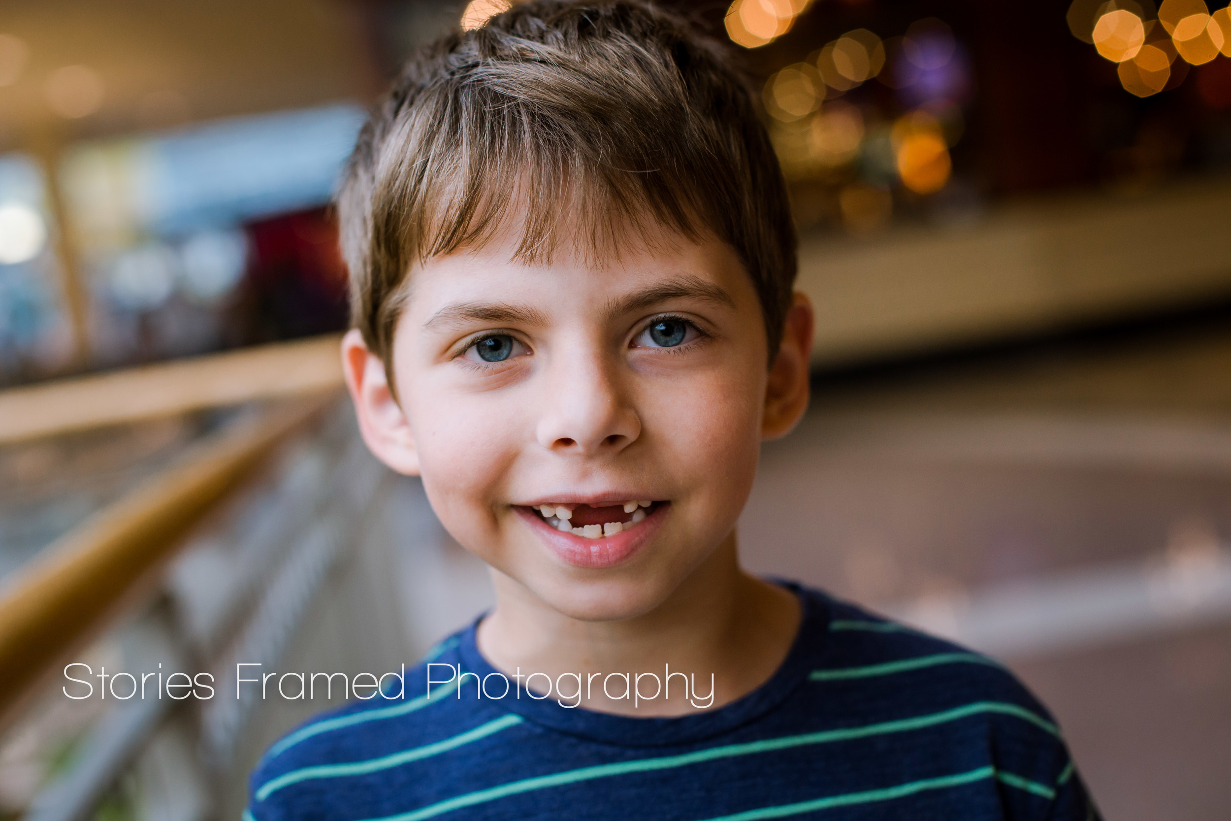 Stories Framed Photography | lost teeth | child portrait