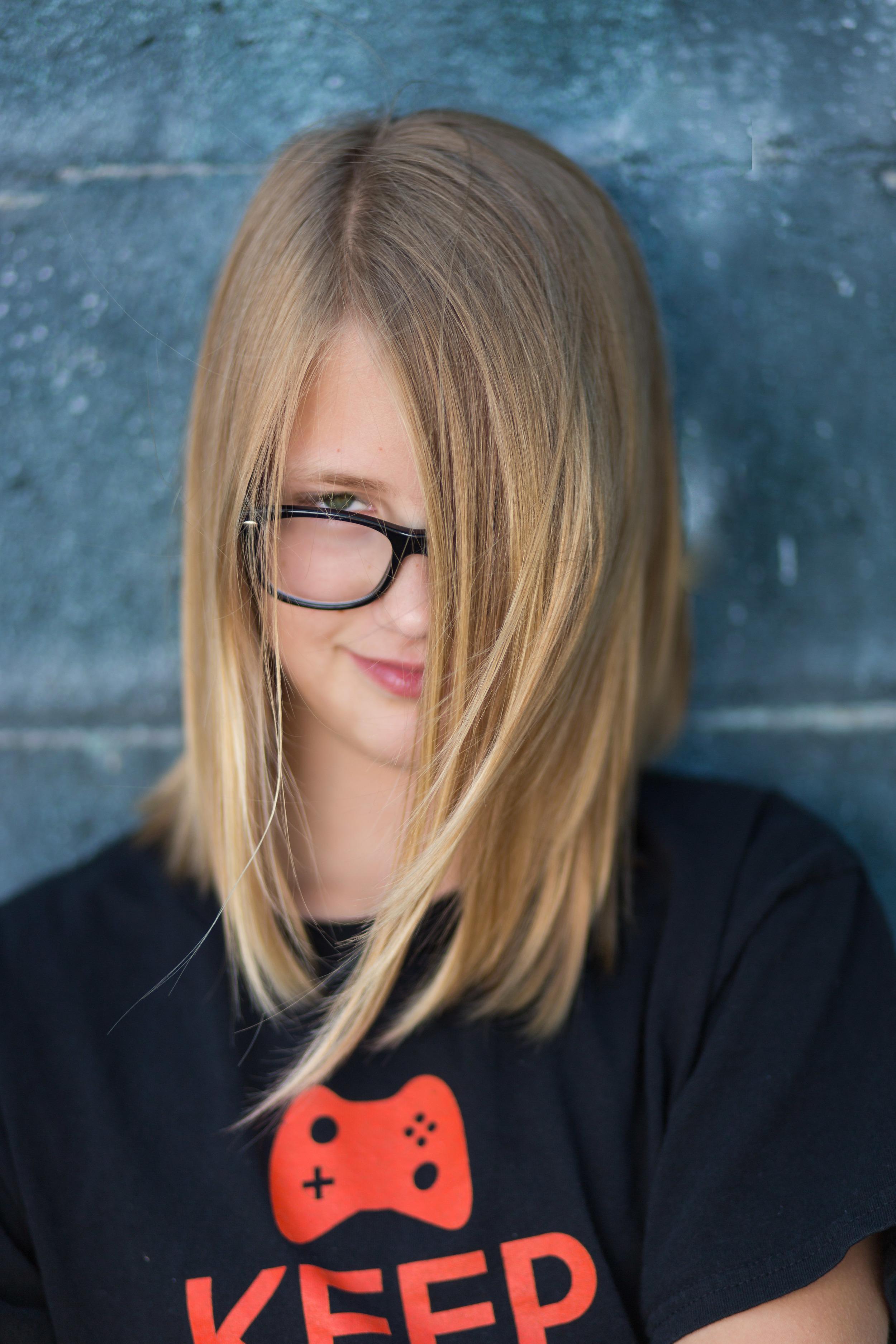 tween portrait of a girl wearing glasses