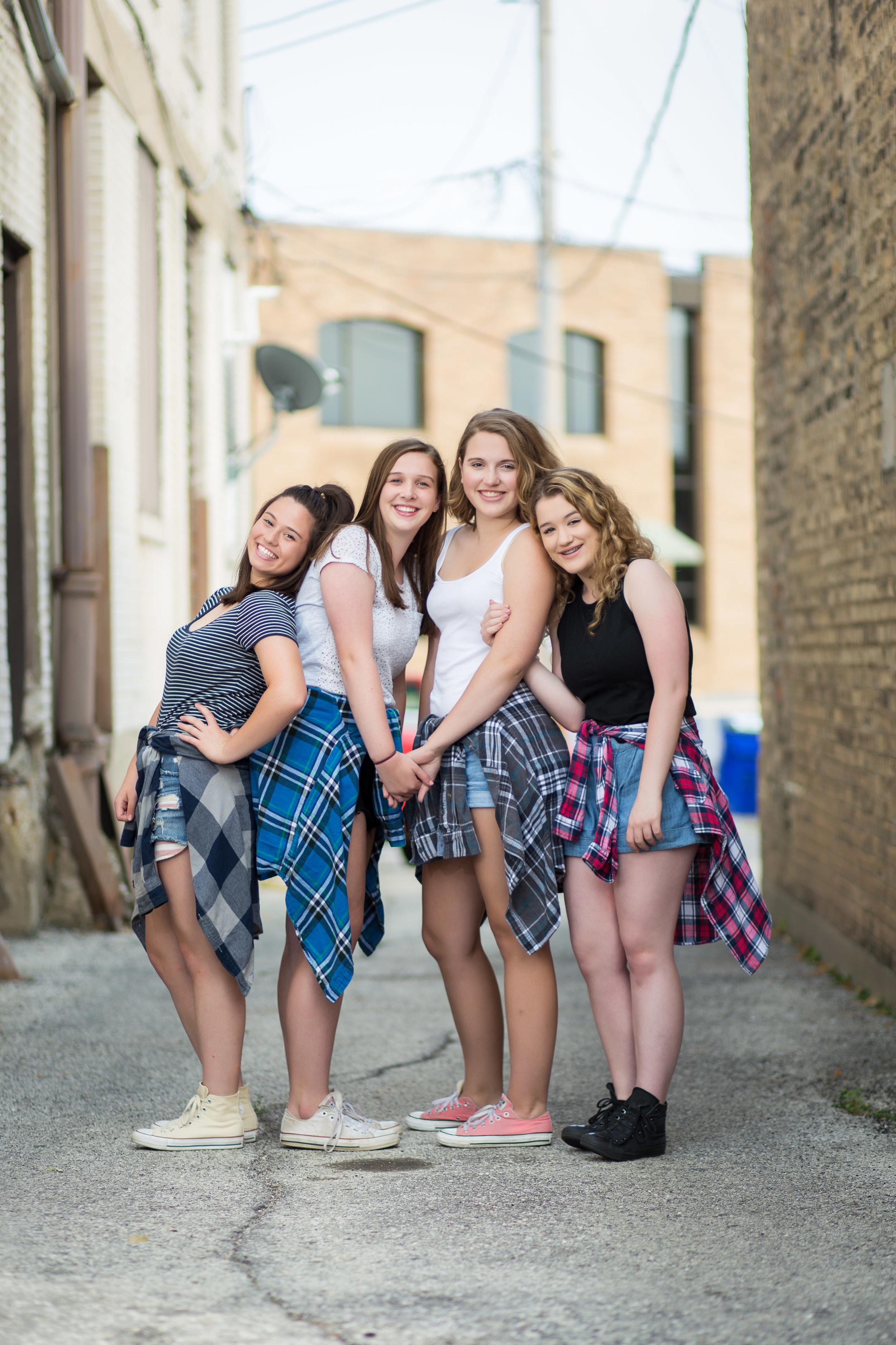 group tween portrait of four girls in alley