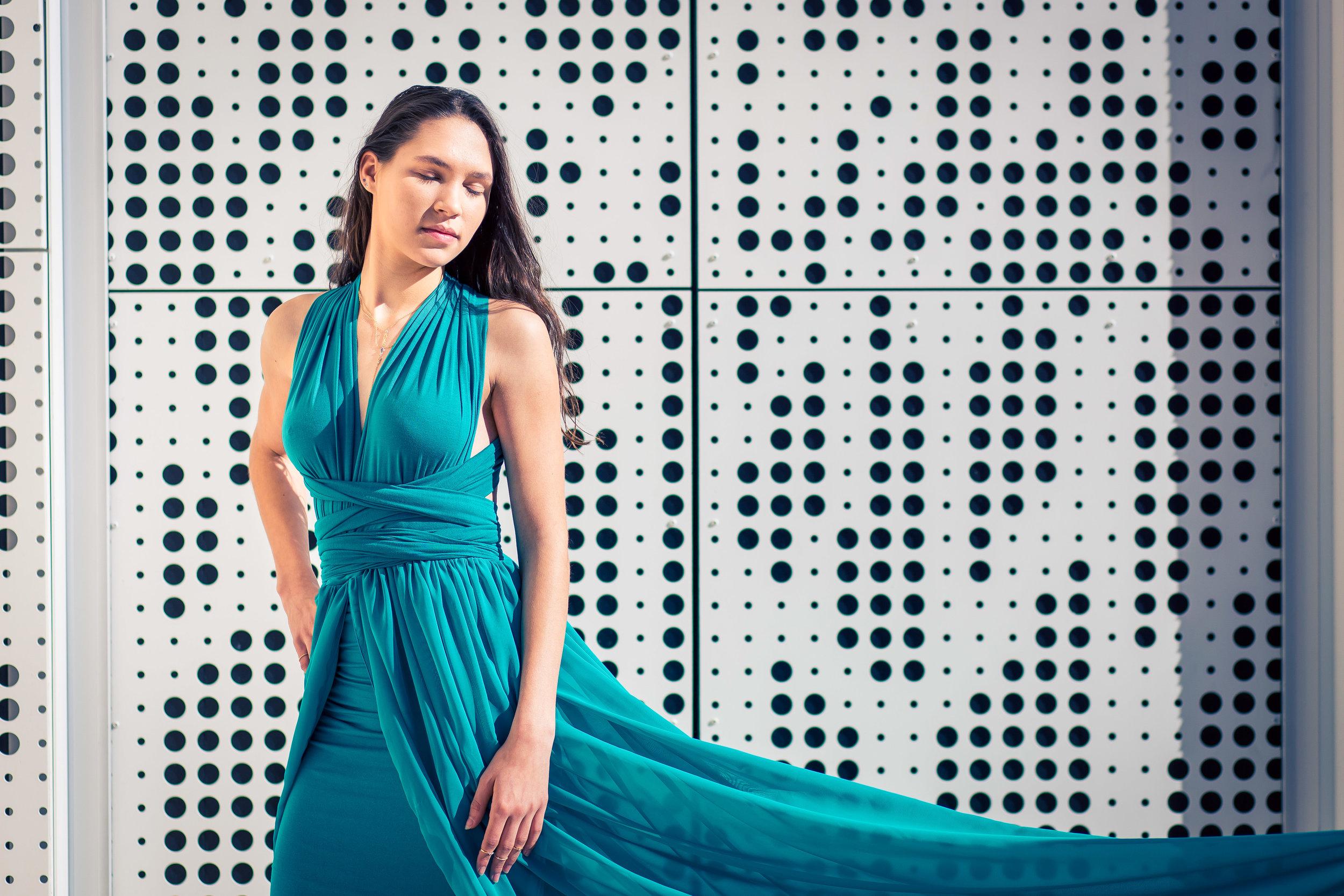 senior portrait of a girl in a long blue dress