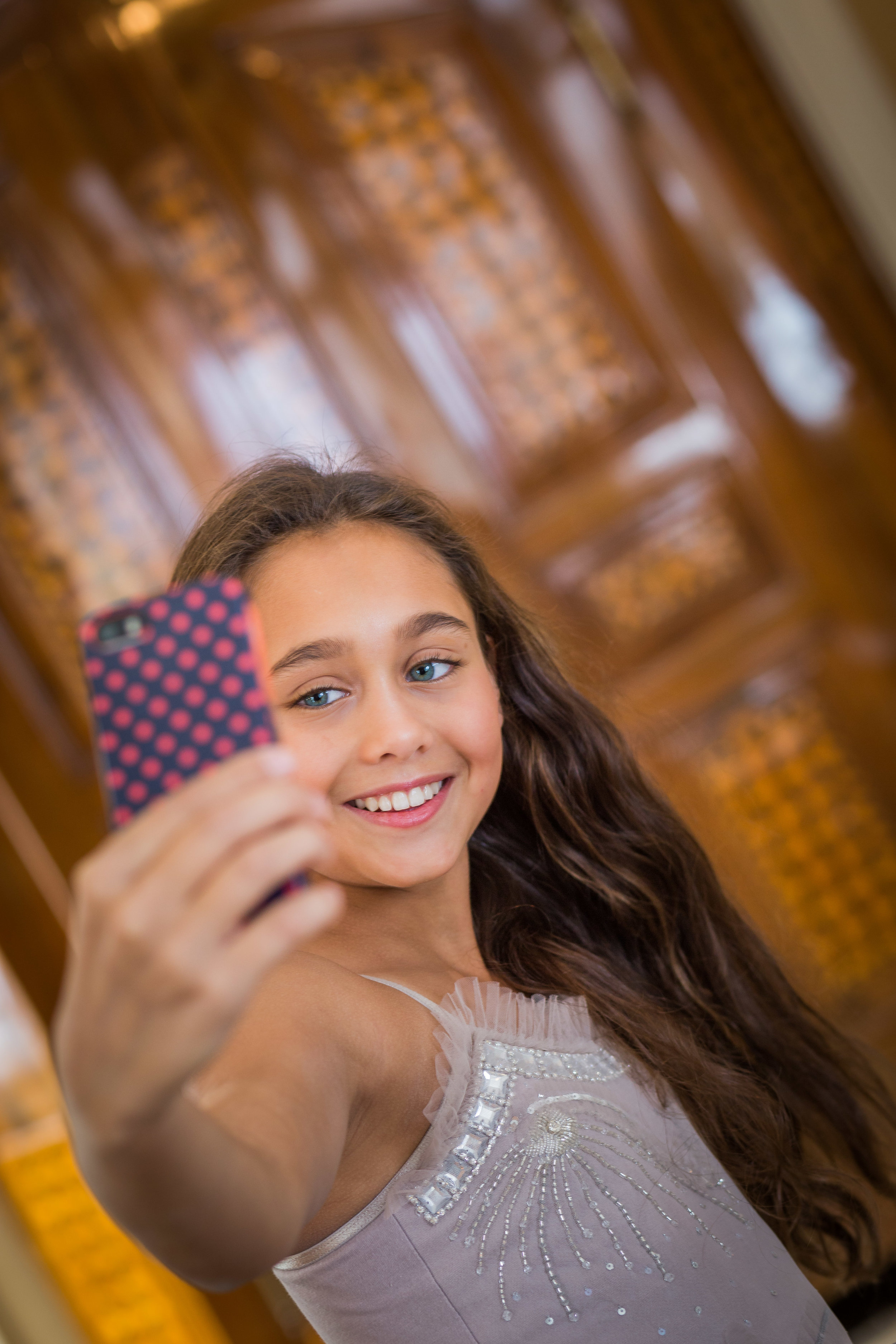 tween portrait of girl taking a selfie
