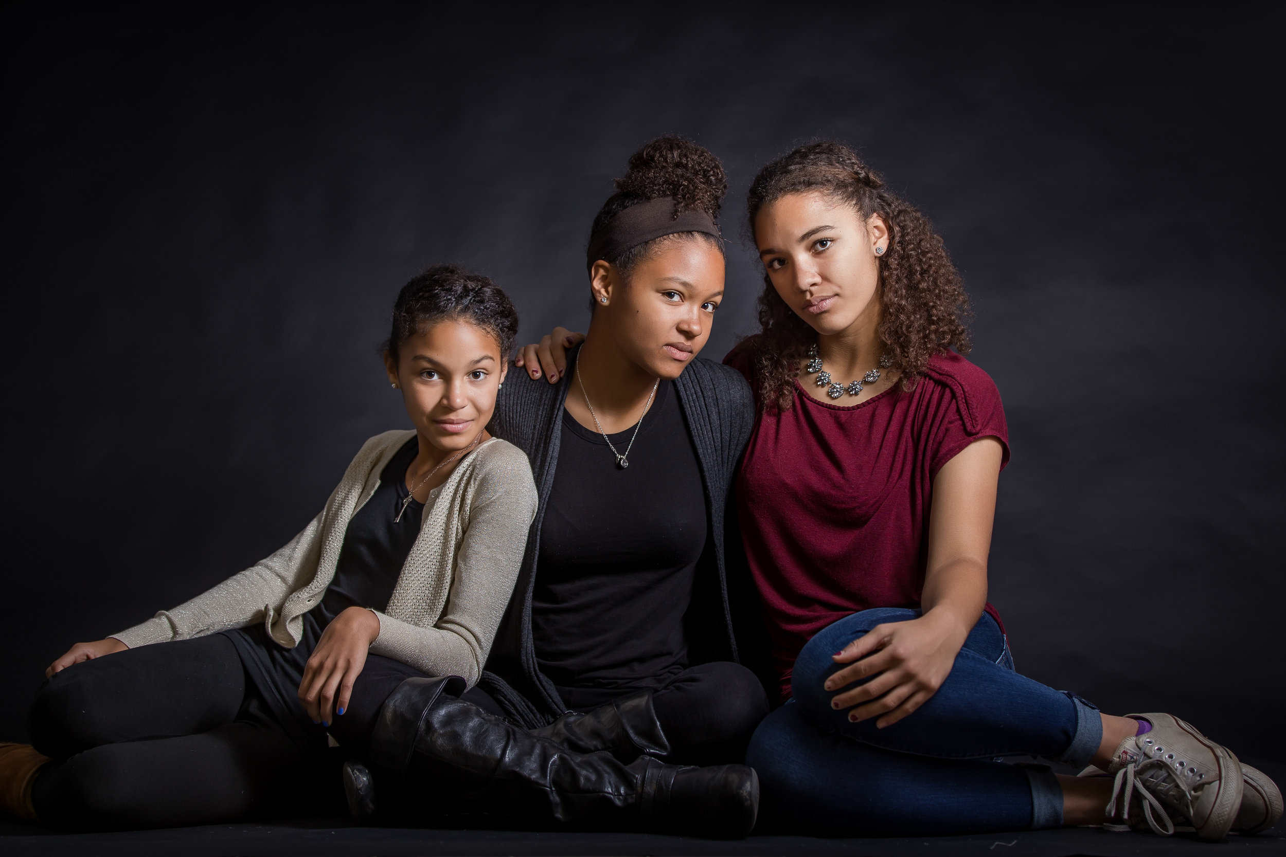 tween portrait of three girls in studio