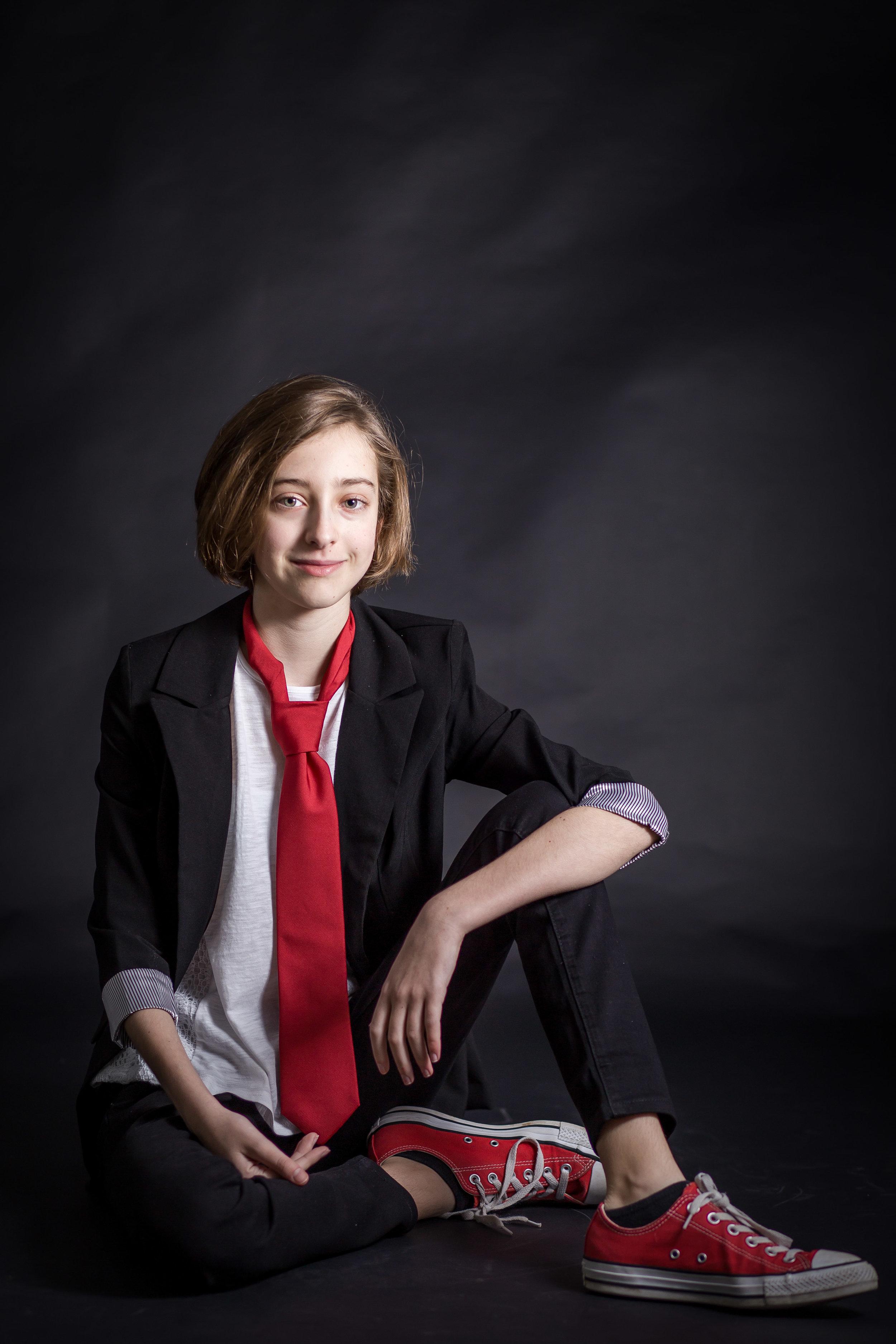 portrait of tween wearing suit