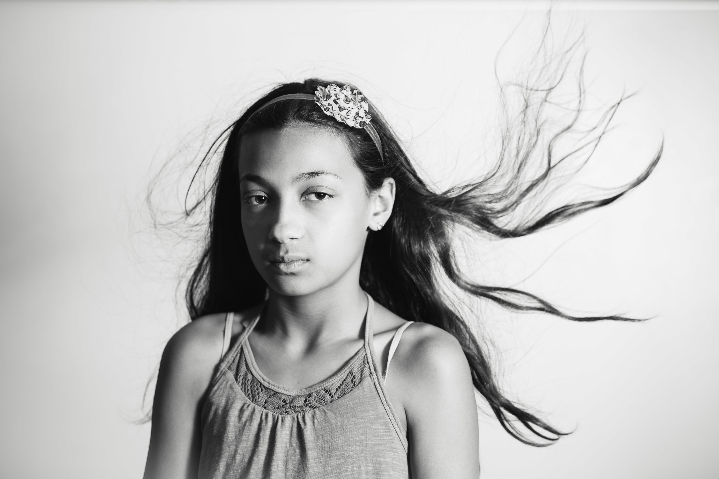 tween portrait of girl with hair blowing in the wind
