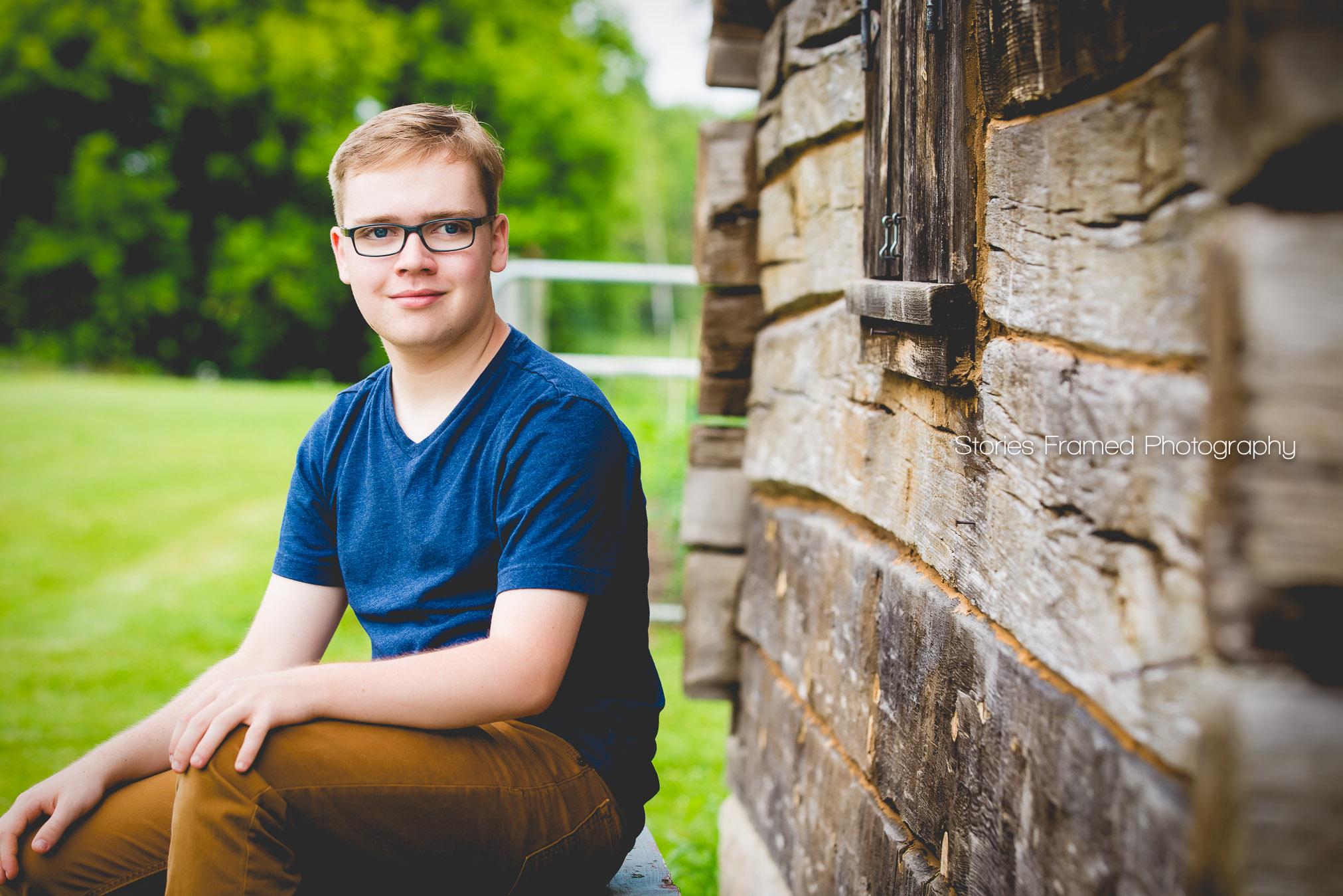 high-school-senior-portrait-boy-by-cabin