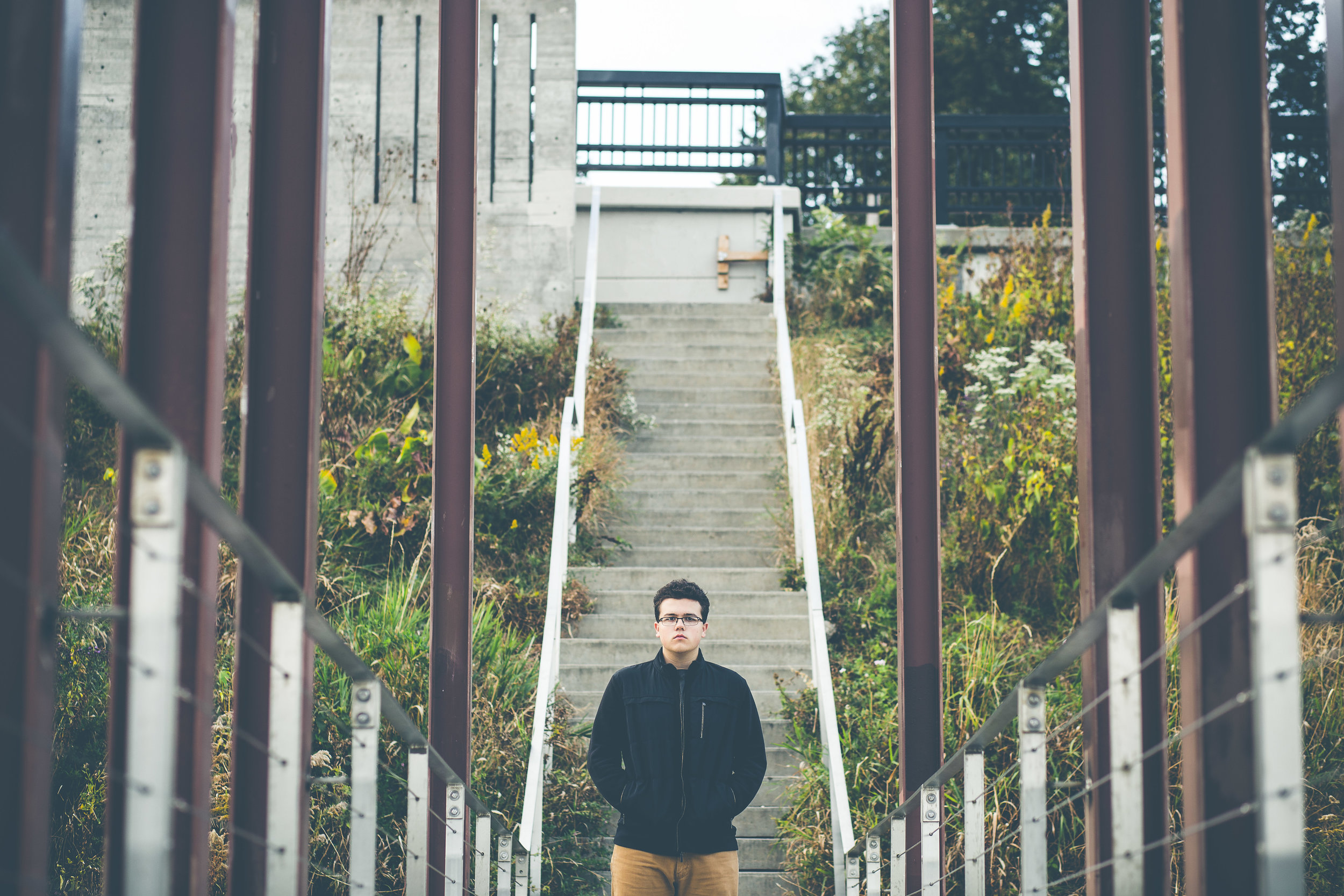 senior photo of boy on staircase