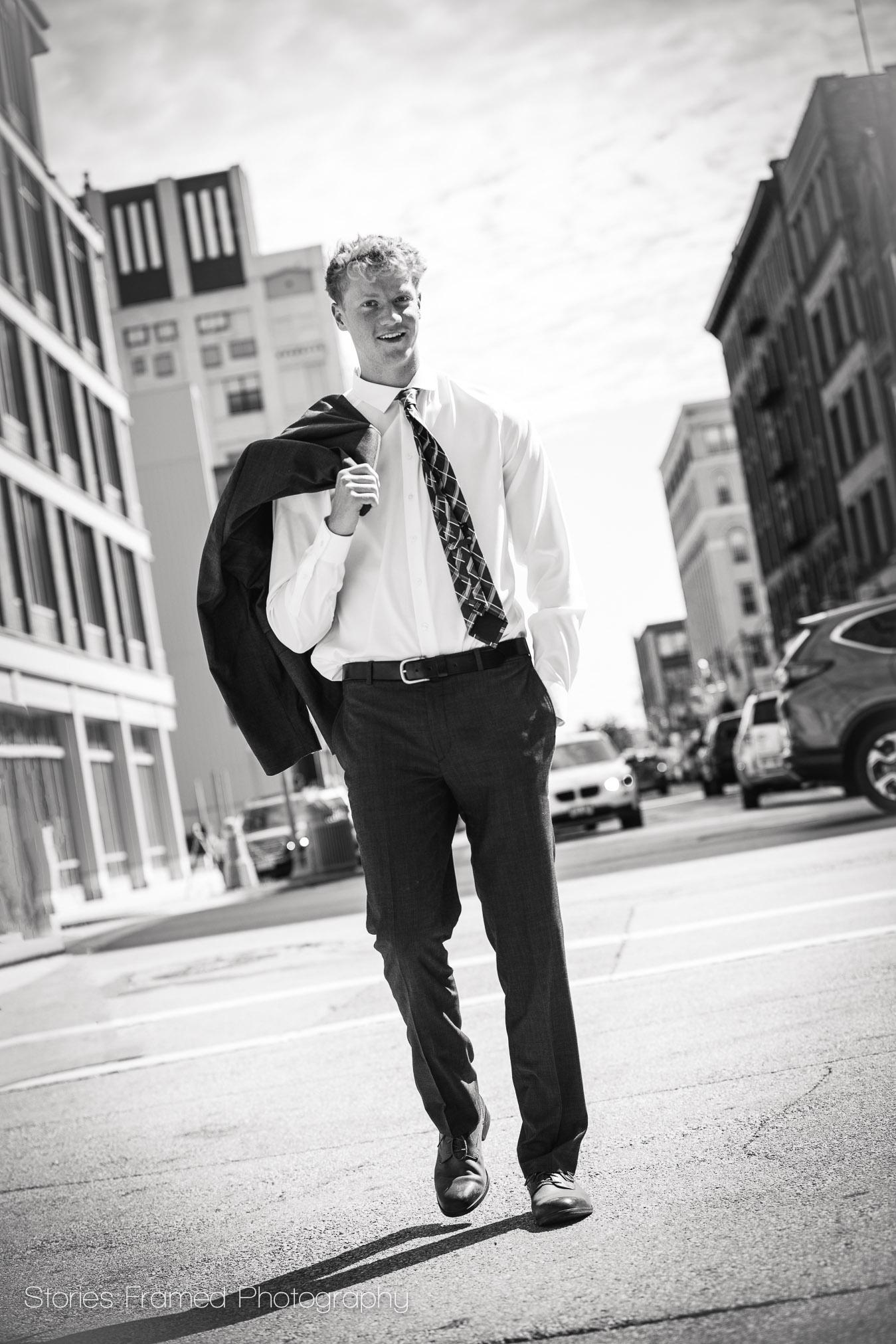Joe-classof2018-walking-down-city-street-in-MKE