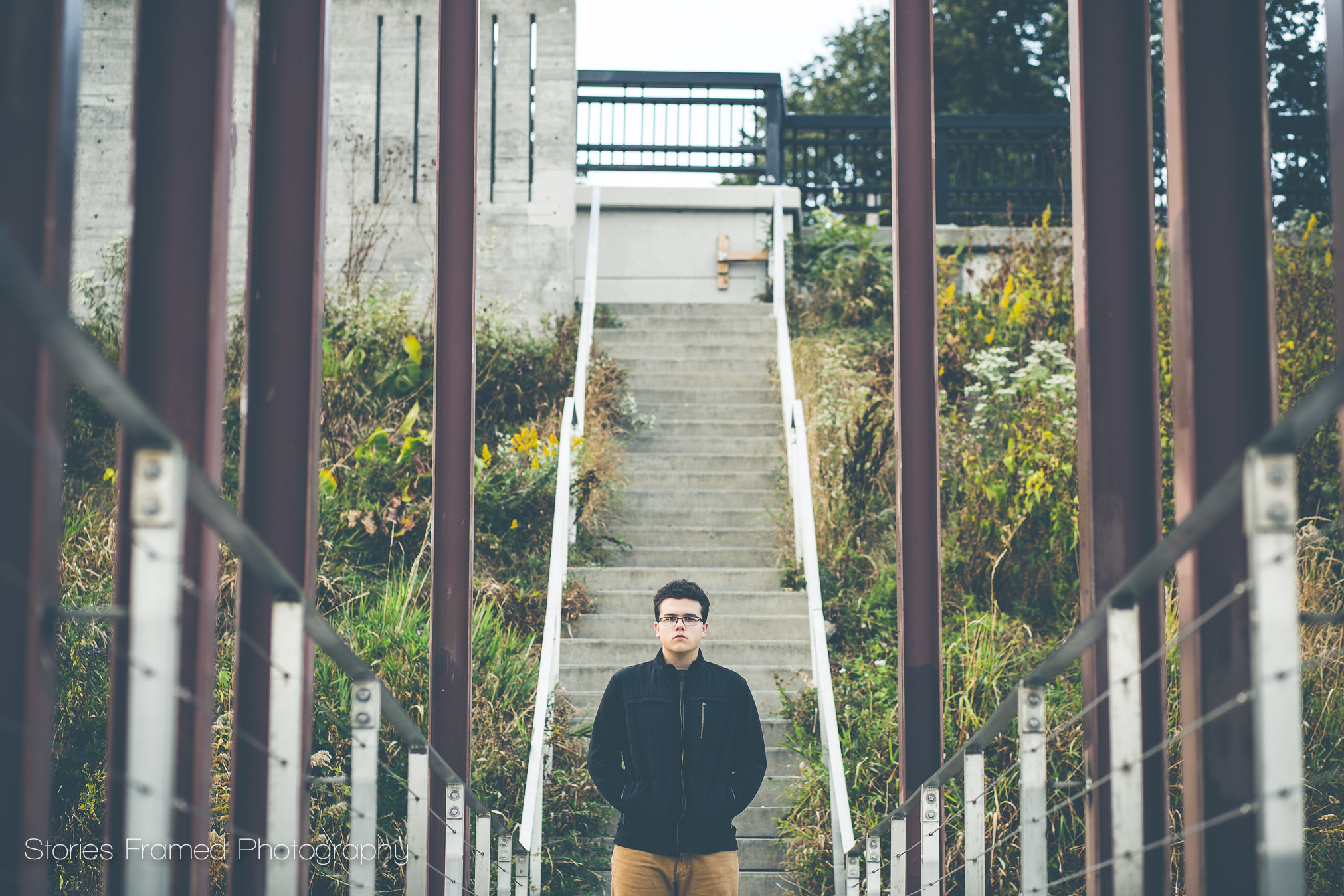 Senior Boy centered on a MKE bridge