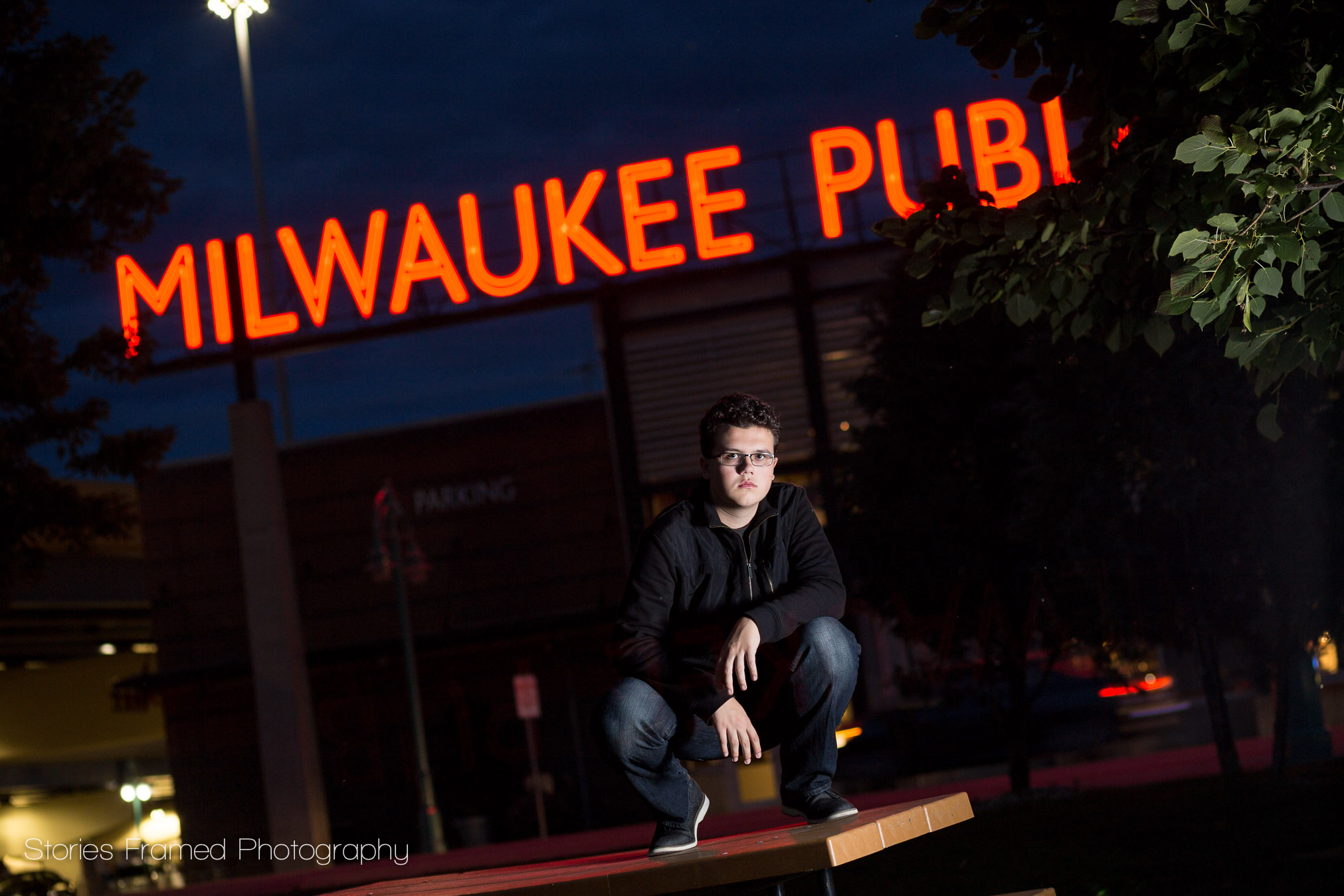 Milwaukee Public Market in senior portrait at night