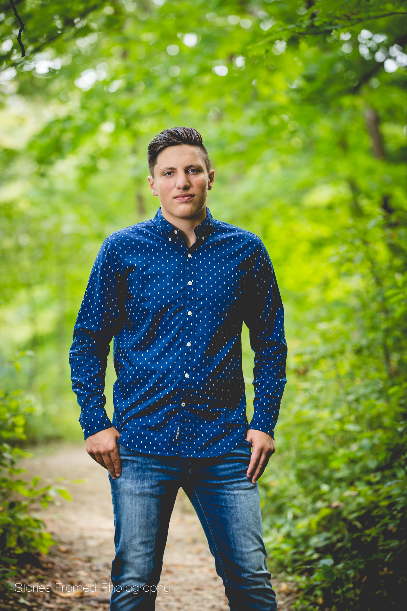 senior portraits in the woods blue shirt