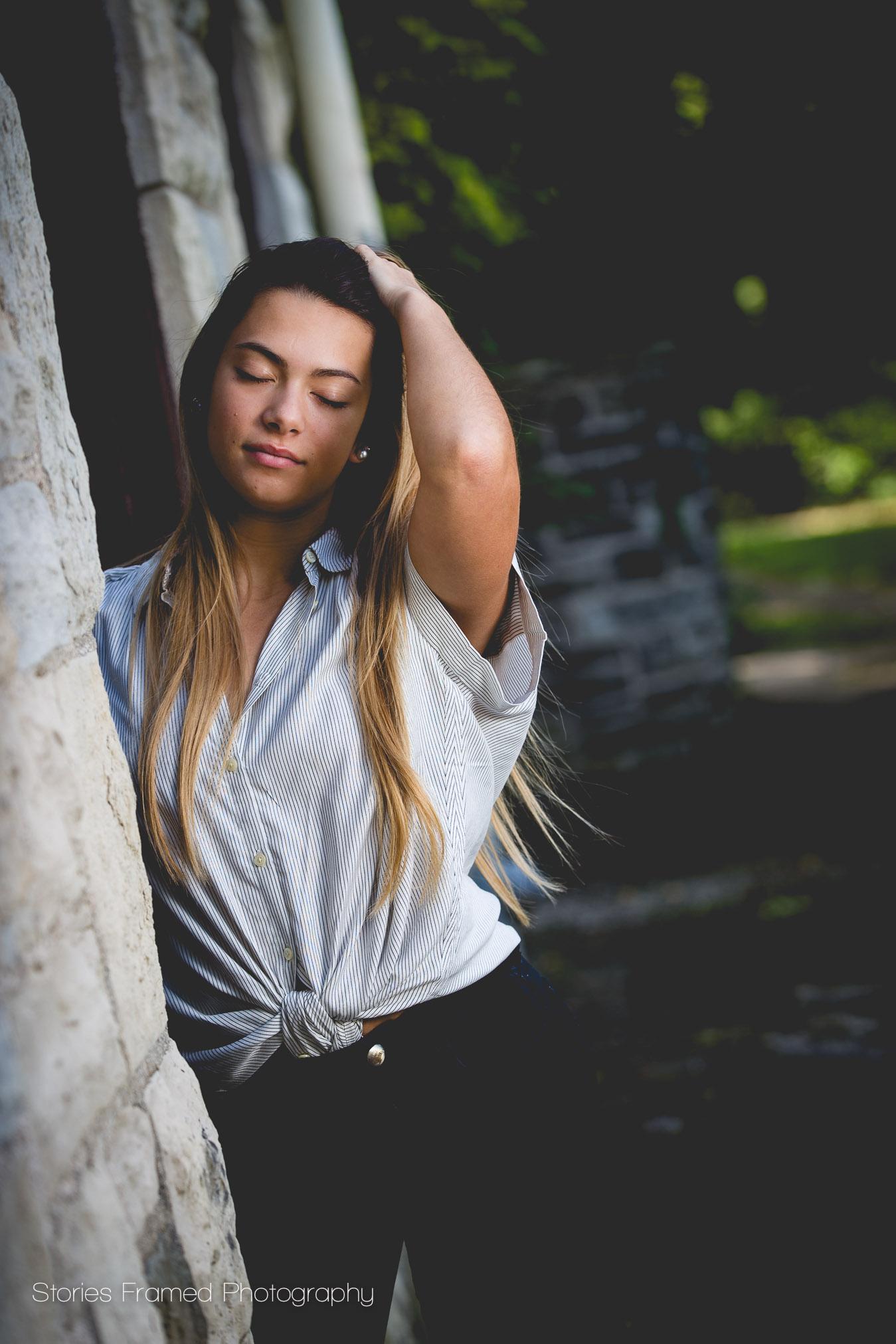 girl-eyes-closed-by-stone-wall.jpg