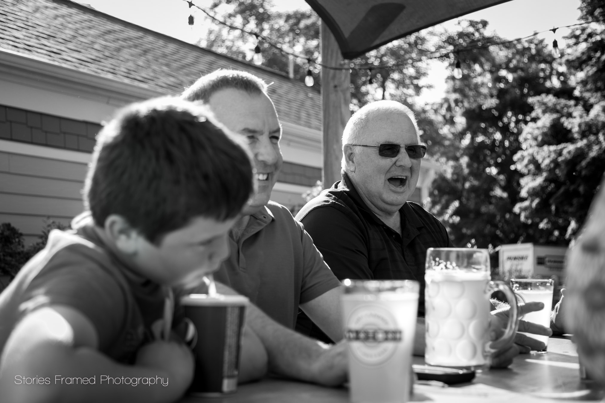 Grandpa enjoying a laugh during Father's Day photos.
