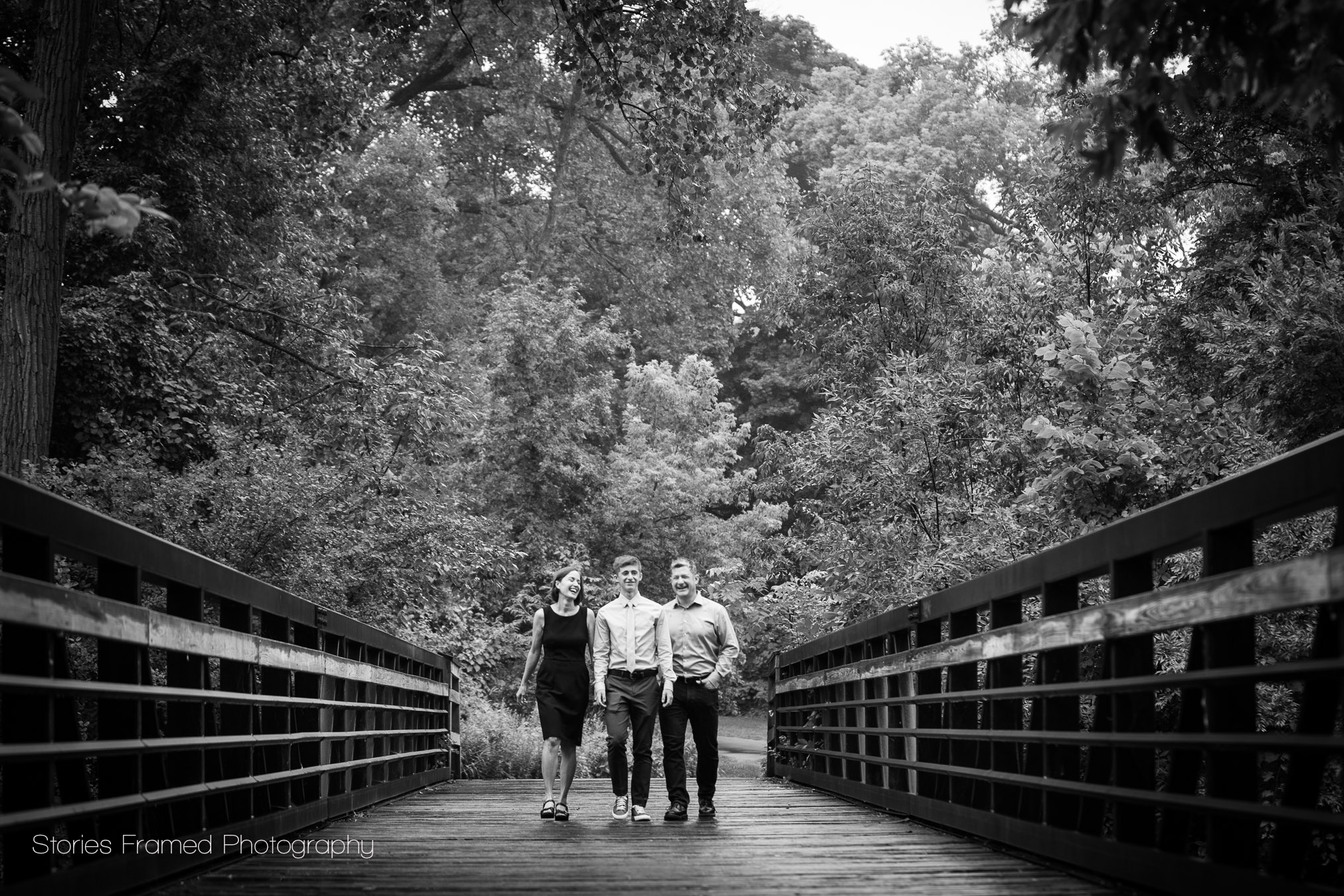 Family walking across a bridge in Wauwatosa