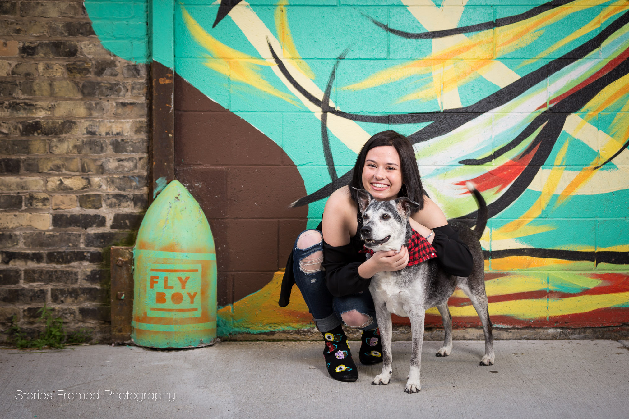 girl and dog in painted alleyway