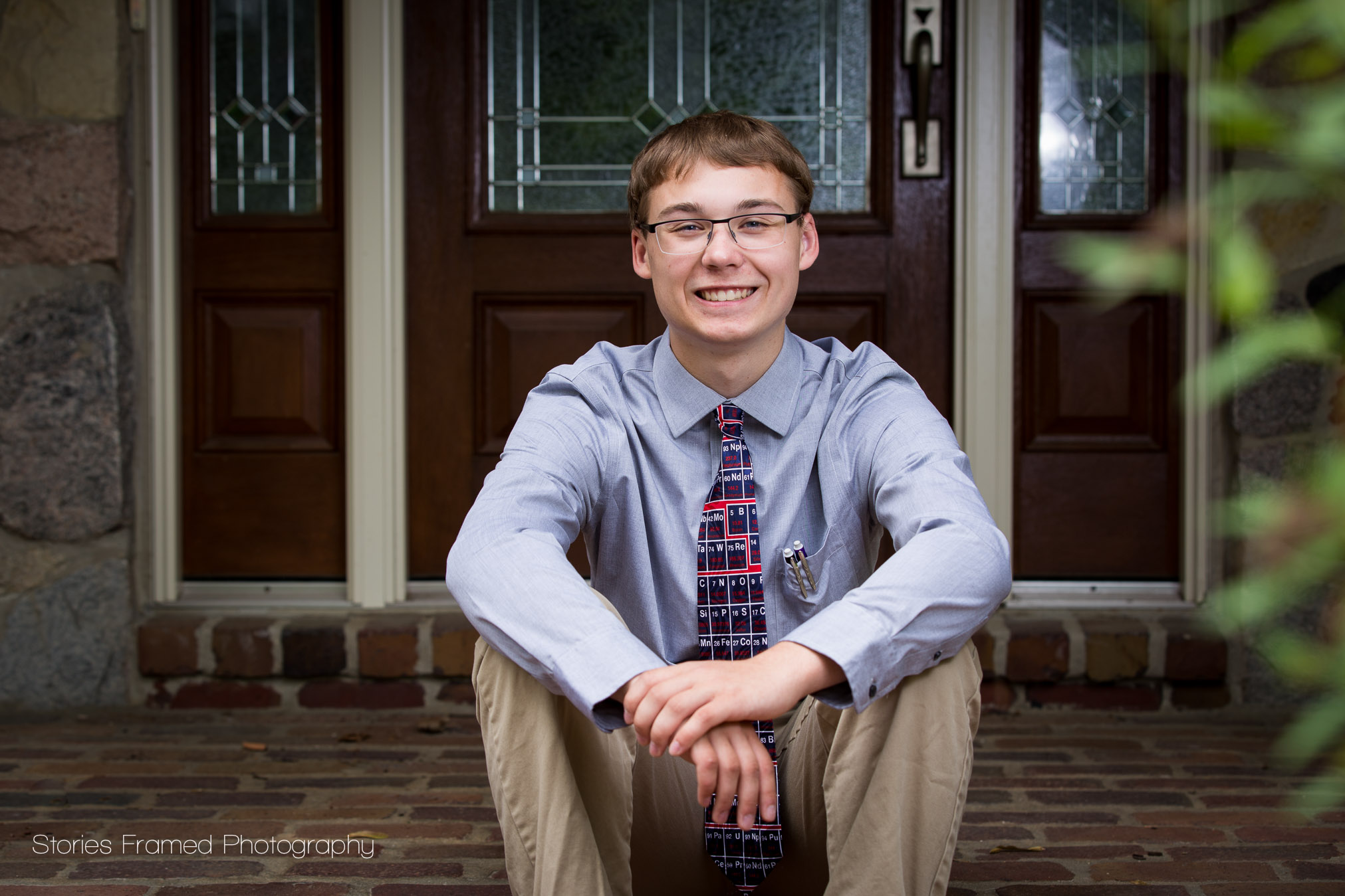 high school boy in tie outside home