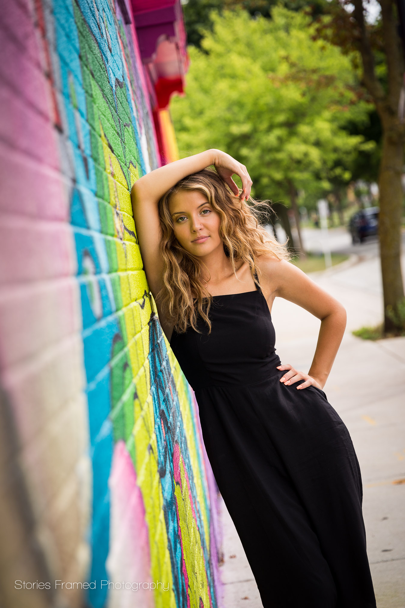girl-leaning-on-grafitti-wall-east-tosa.jpg