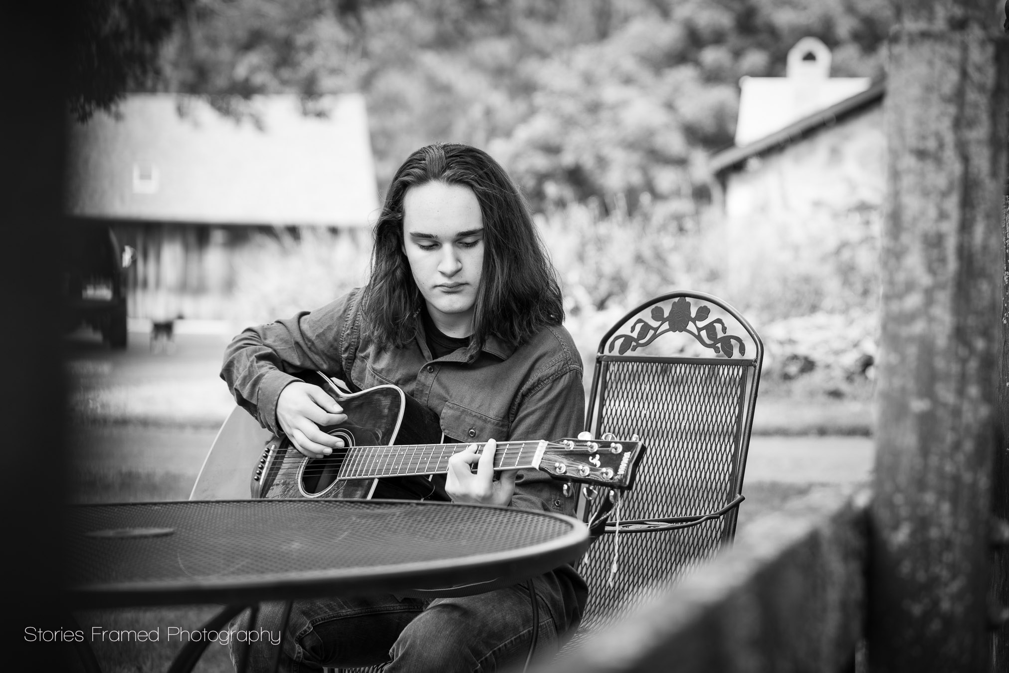 boy-playing-guitar-on-farm-bw.jpg
