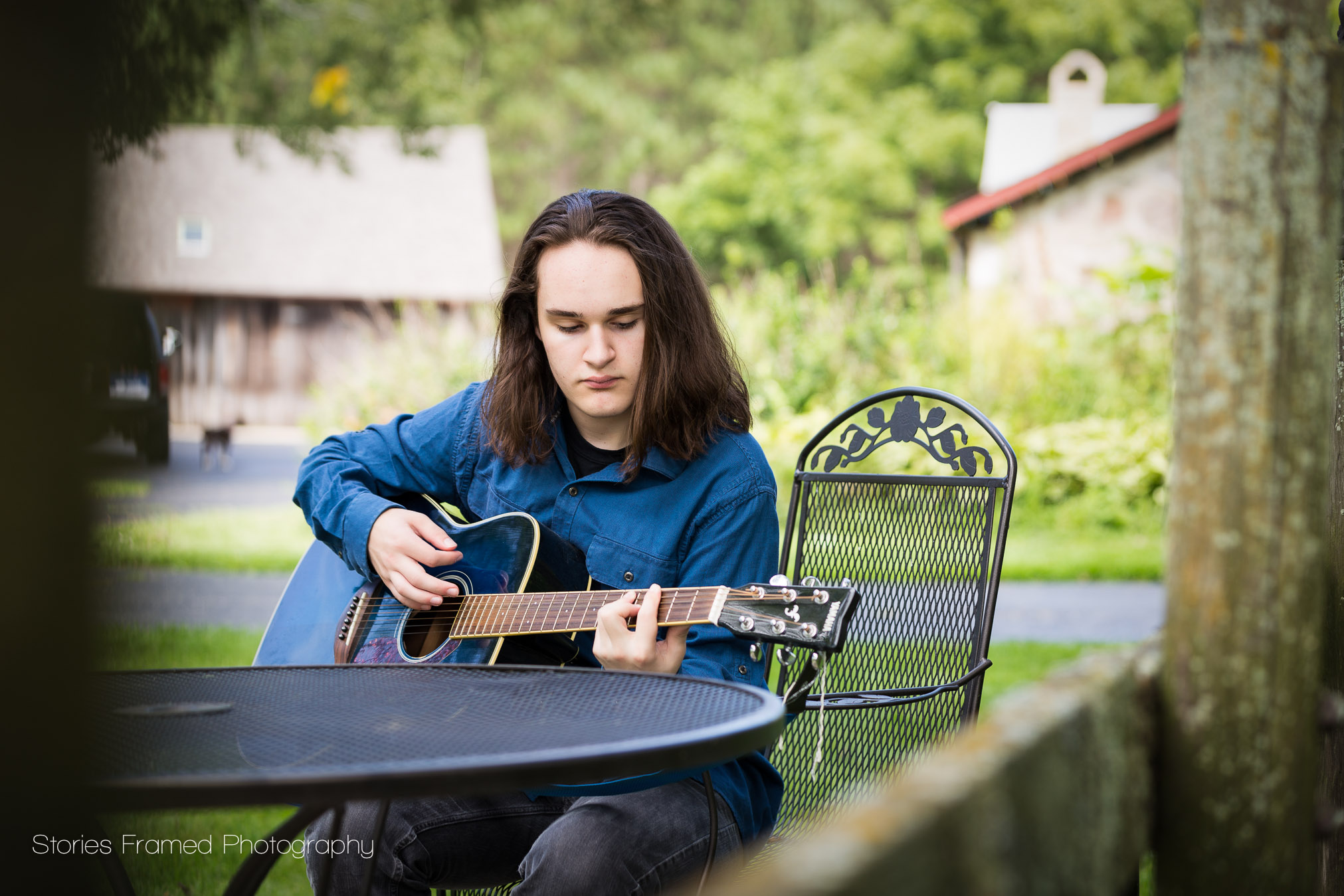 boy-playing-guitar-on-farm-color.jpg