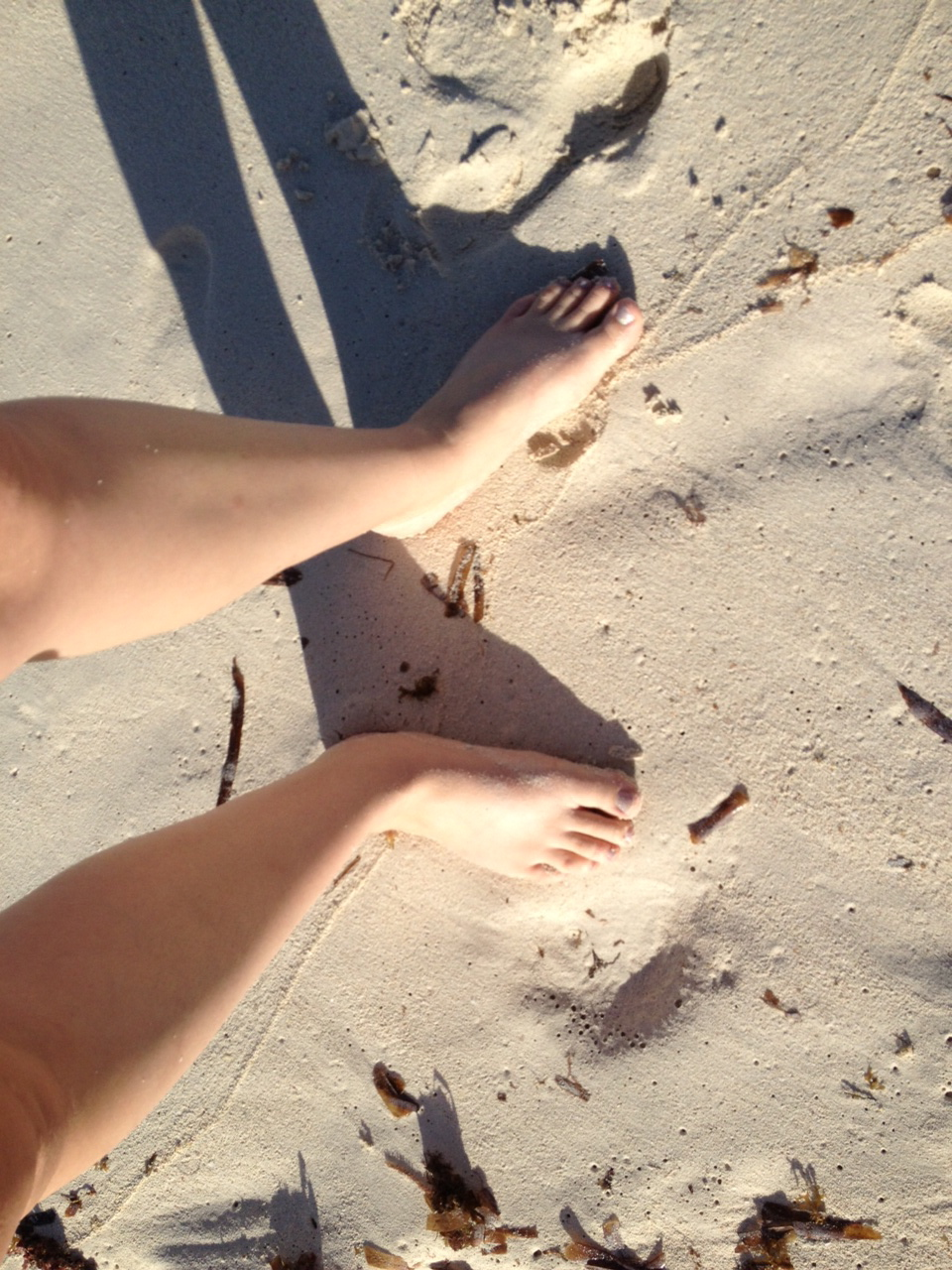 feet in the sand.jpeg