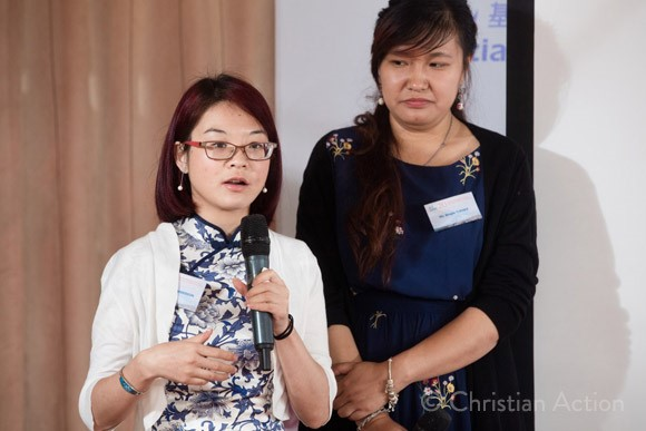 Abigail and Bingjie... - ...share their stories with the group assembled for Christian Action's 20 year celebration