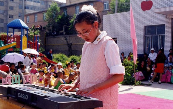 Bingjie Playing Piano.jpg