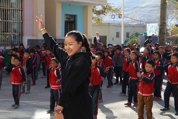 Jenny leads the students in a dance.