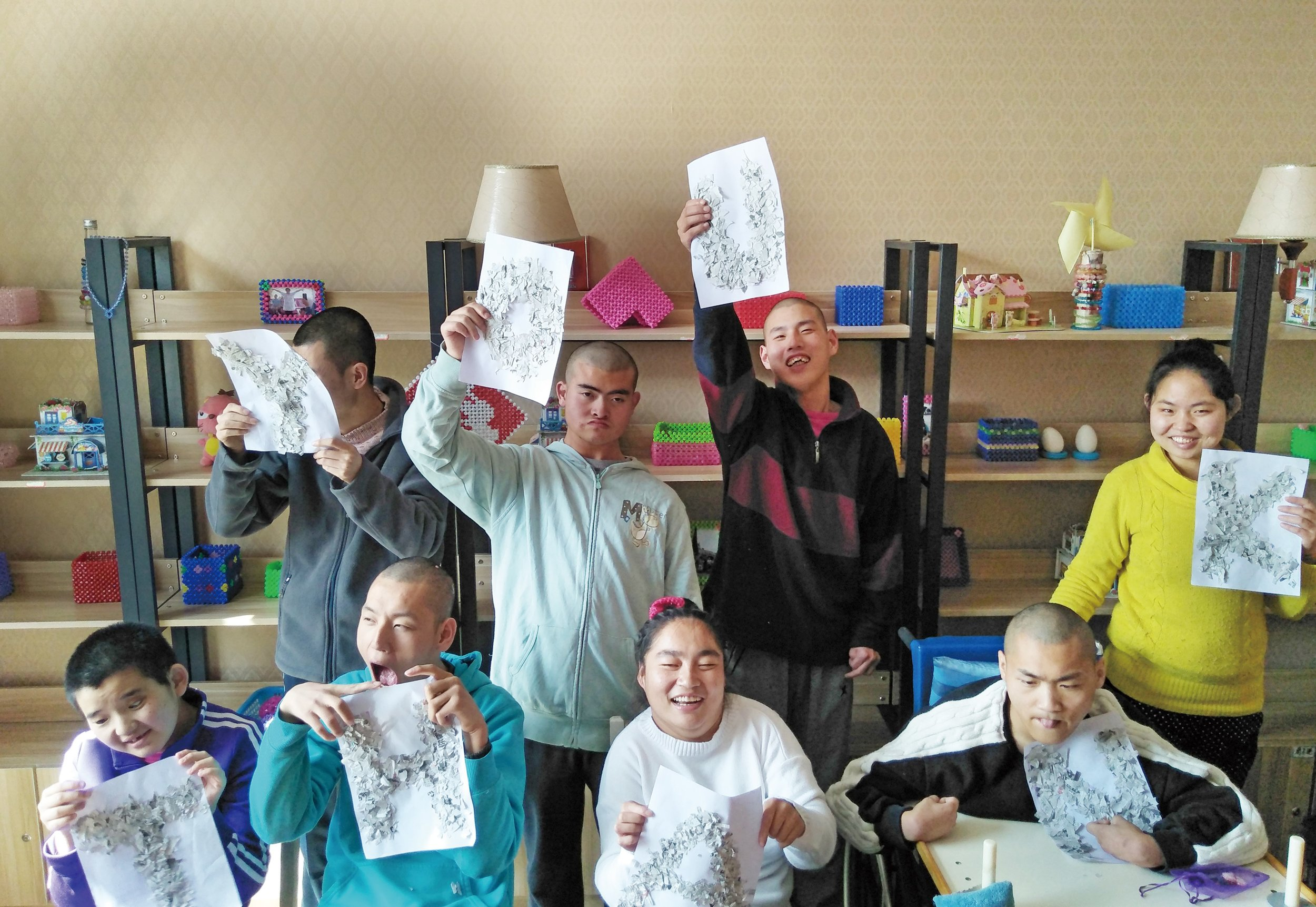 "Fei Fei (back row, 2nd from left) and other participants in the Christian Action Bridge Program holding up their handmade ""Thank You"" cards."