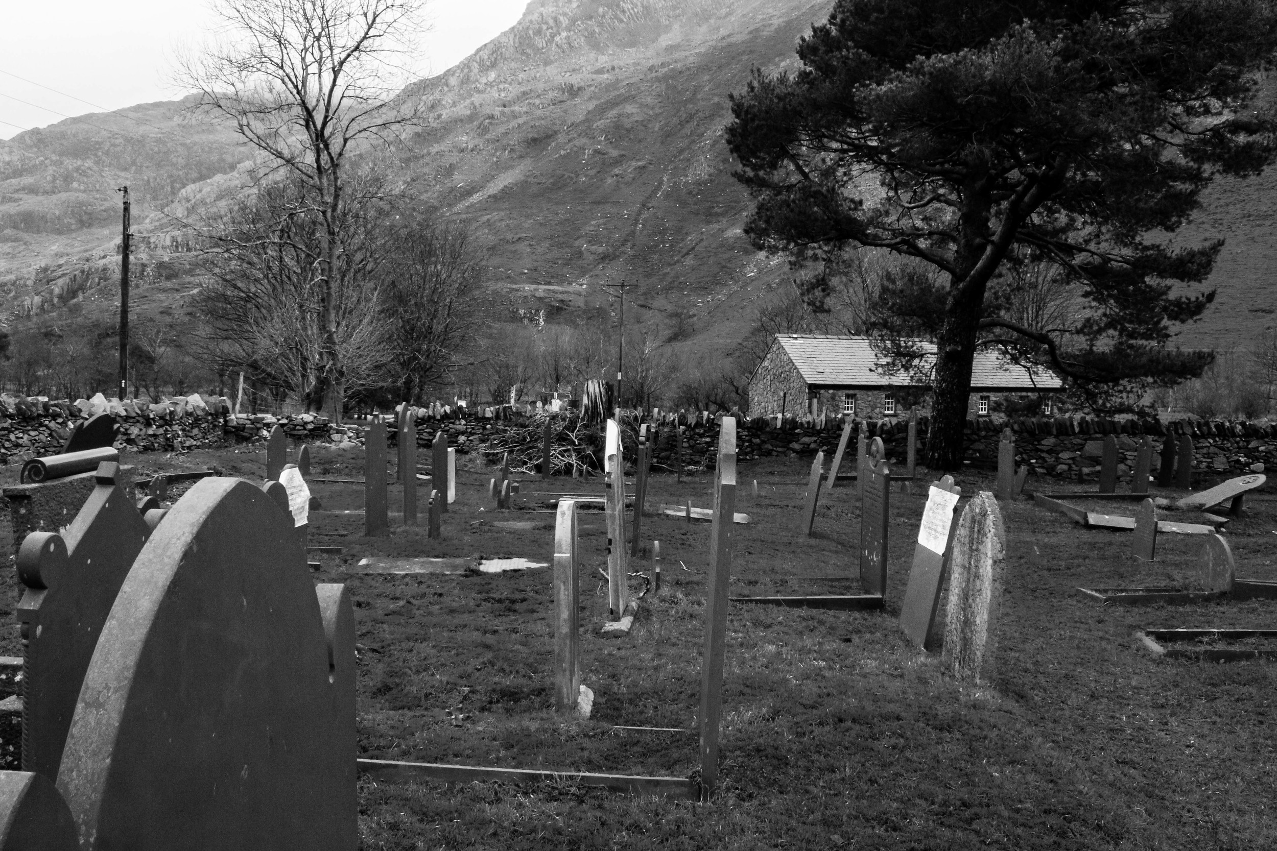The Williams' family graves: Griffith (jr), Owen, Ellen and Robert. All in a line in the South East corner of Nantperis Graveyard. Facing their home, Coed Gwydr.