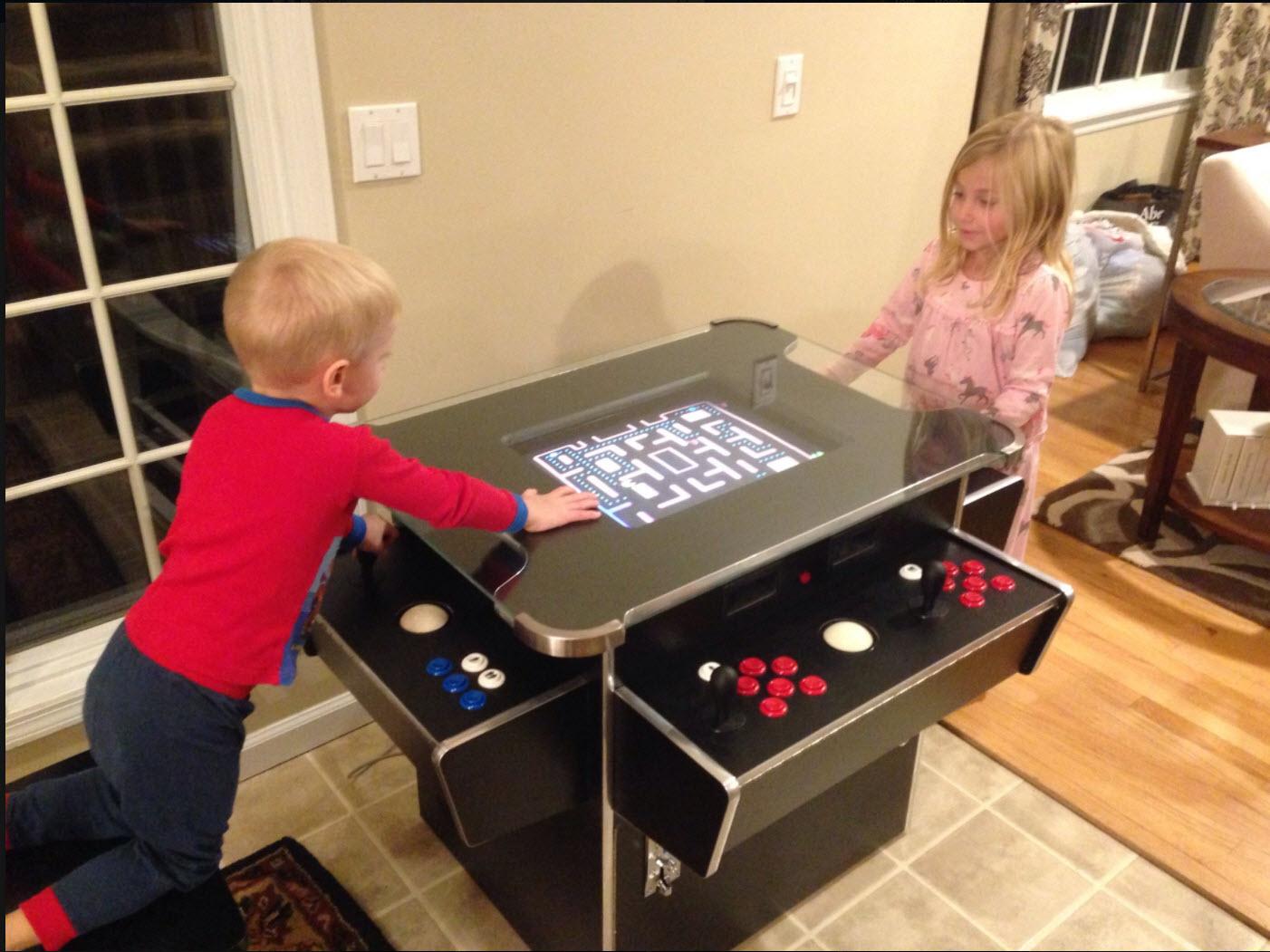 Thomas and Kate - arcade table.jpg