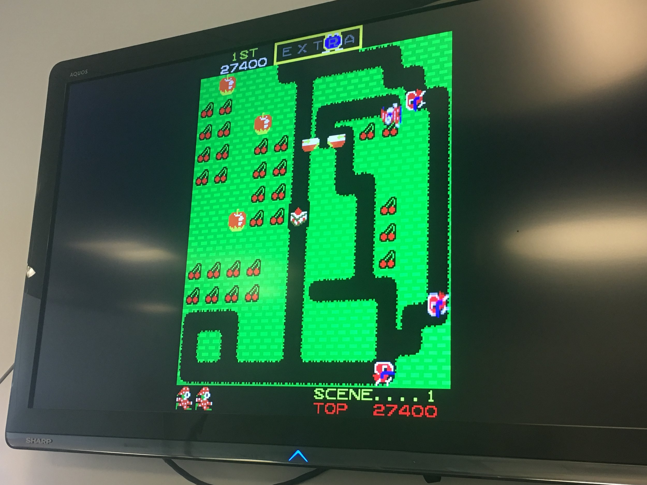 Thanks to emulation, the odd spectacle that is Mr. Do! is now playable in my office.  Booyah!