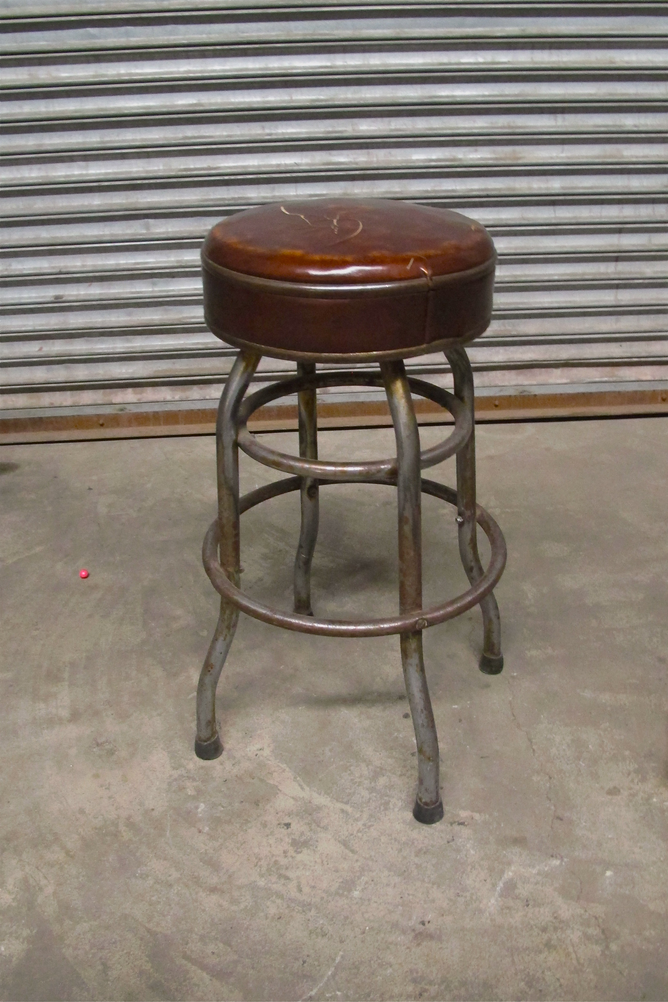 Metal Stool with Brown Leather Upholstered Seat $25