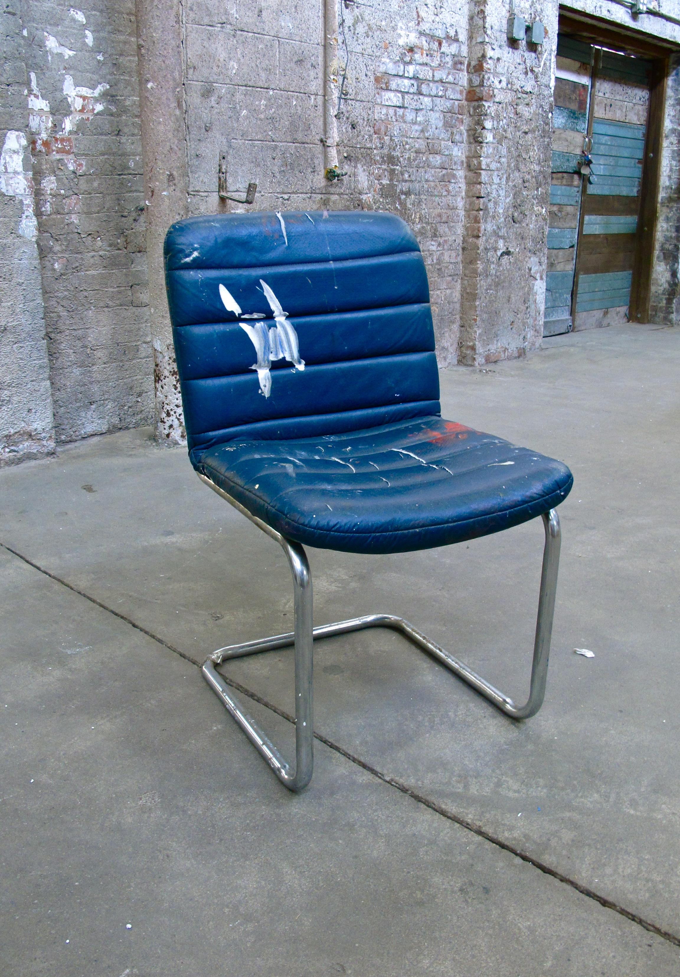 Blue 'Paint-splattered' Upholstered Armless Chair $30
