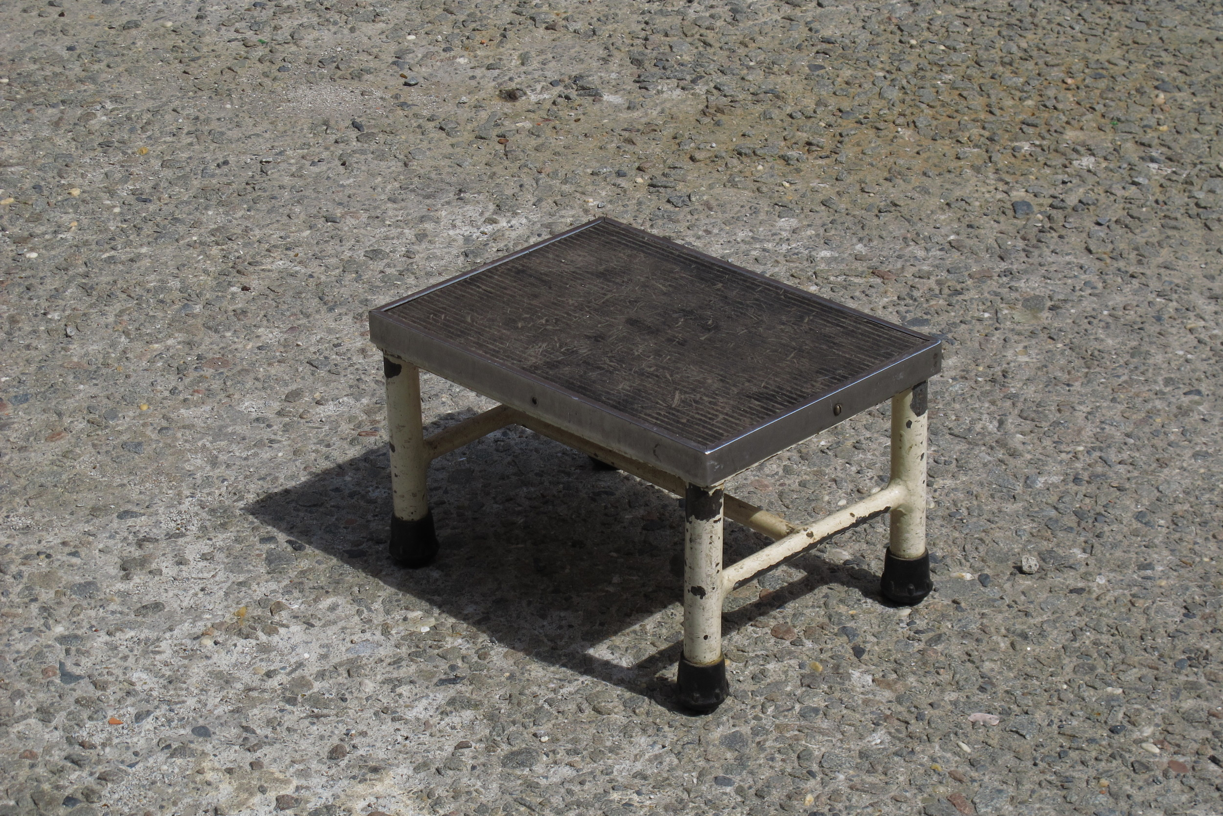 Short metal and rubber step-stool $30