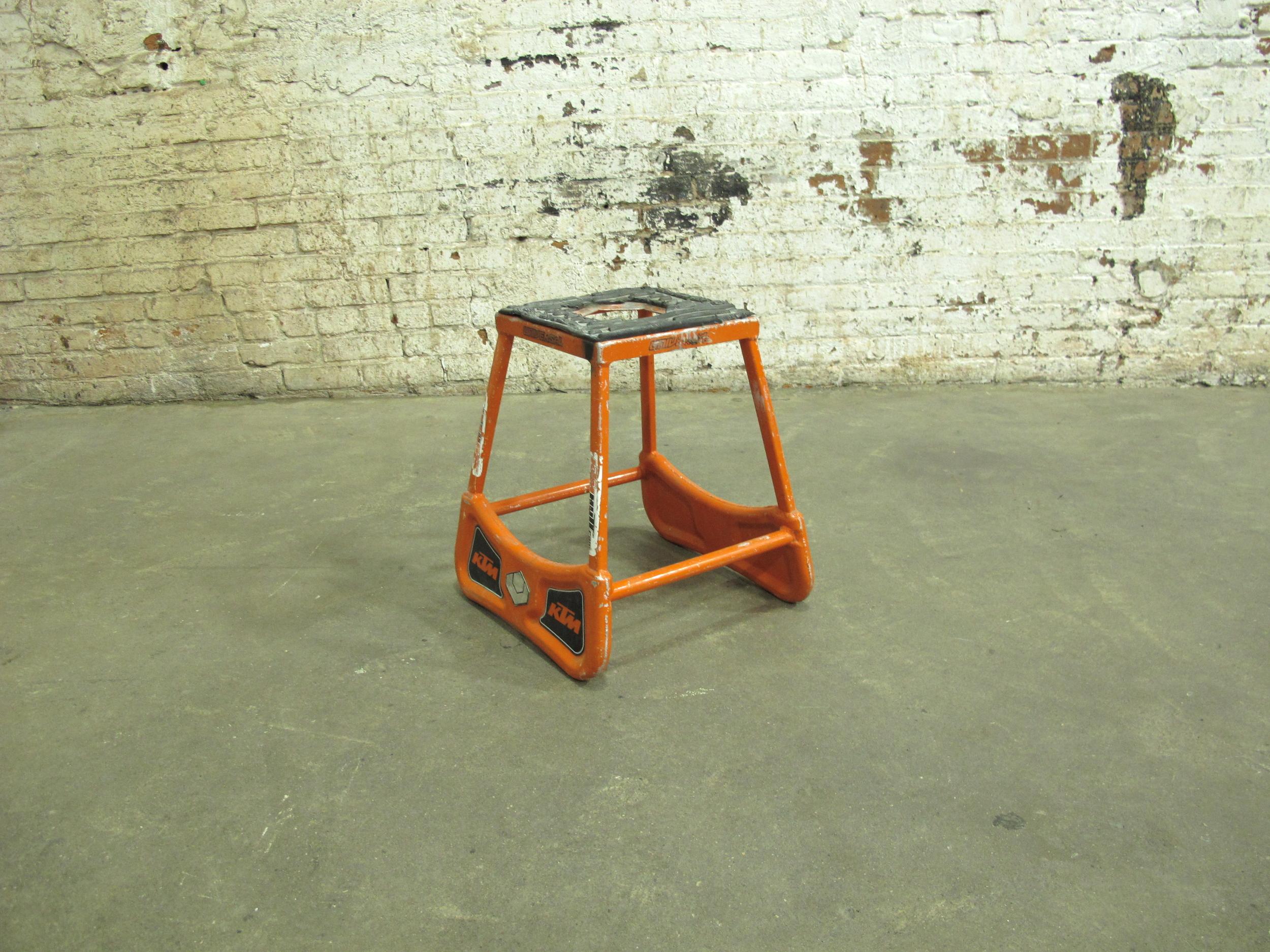 Short Orange Metal Mechanic's Stool $25