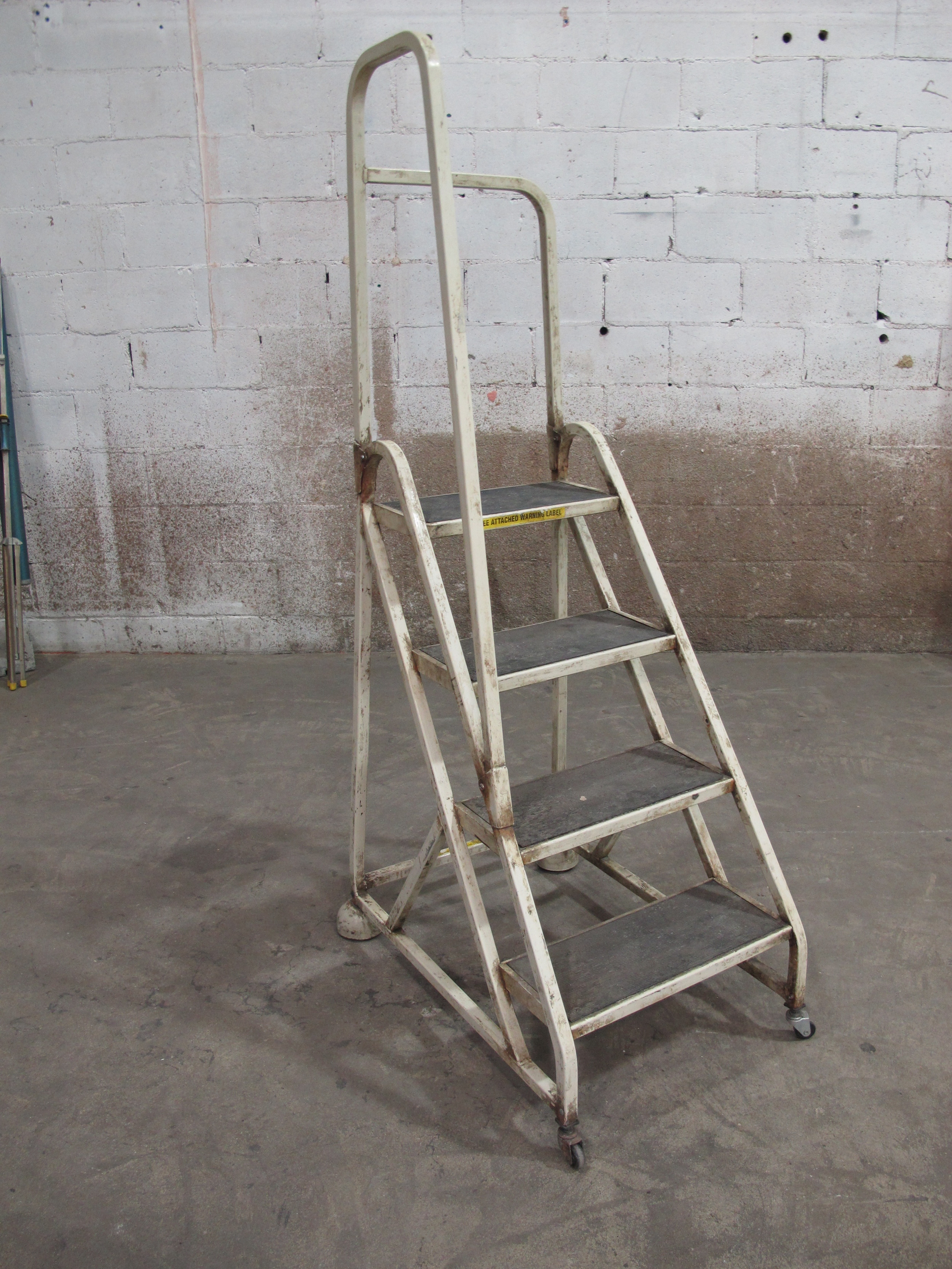 Off-White Metal 4-step ladder on wheels $50
