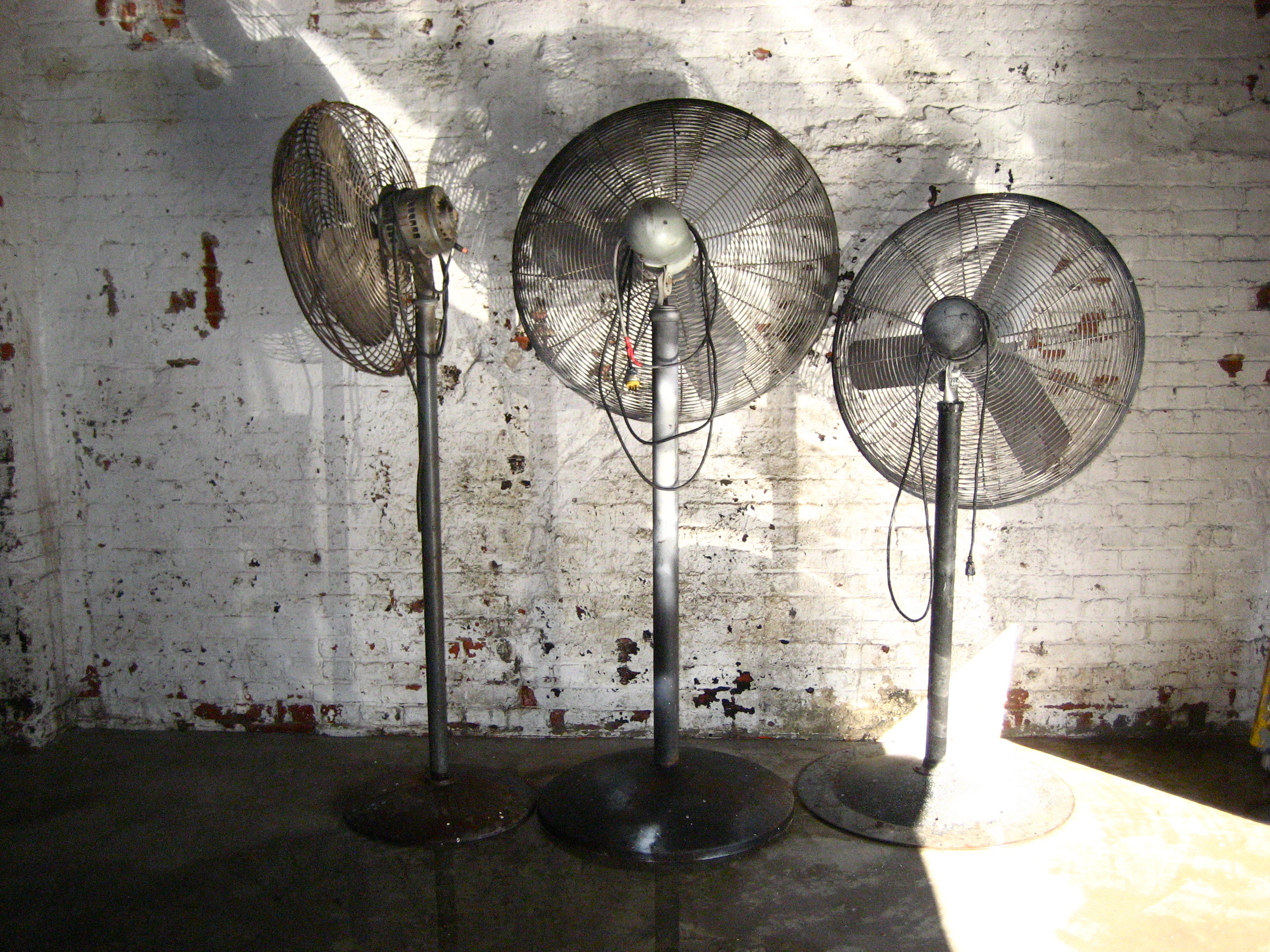 Three industrial metal fans