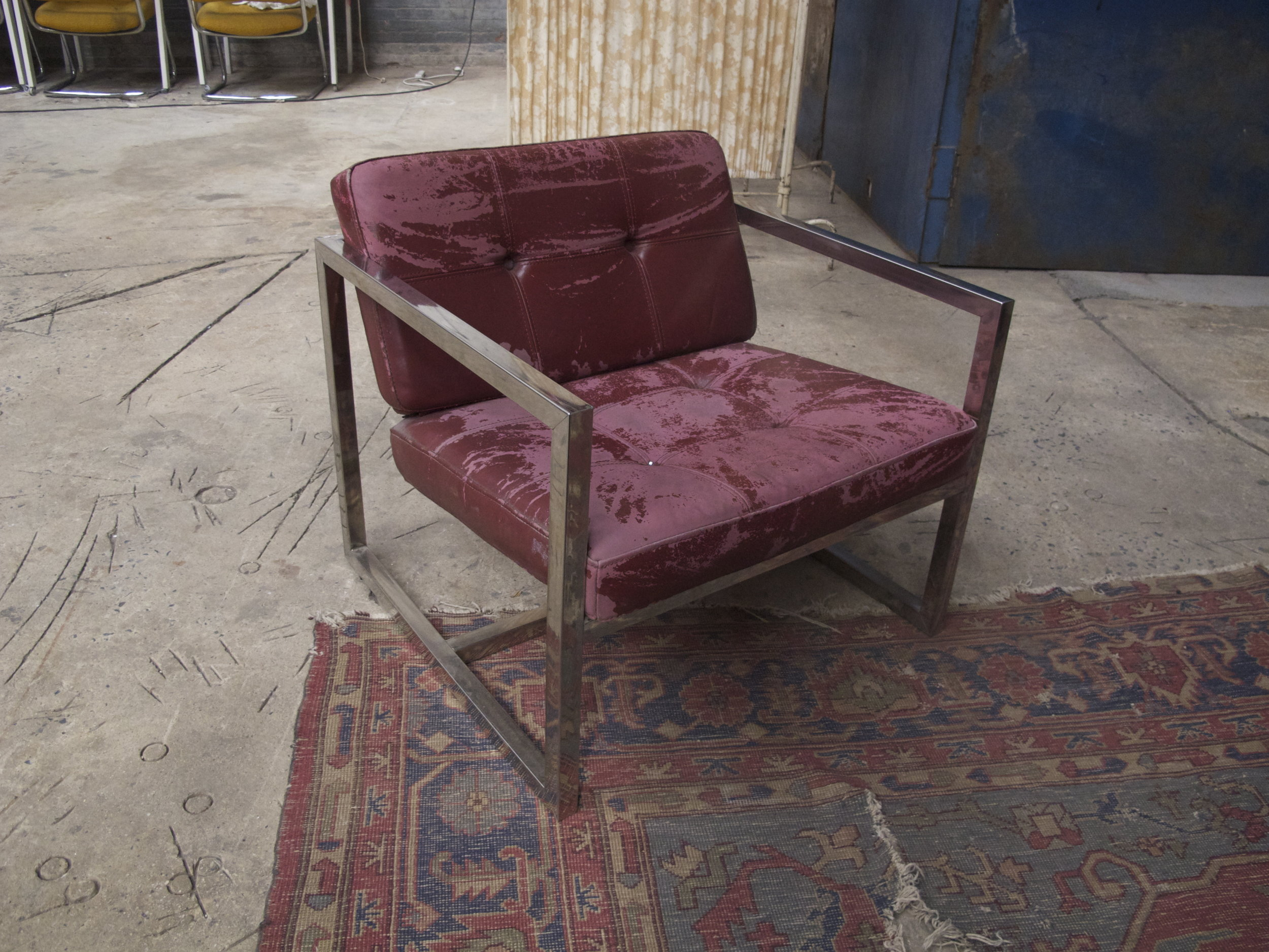 cracked leather and chrome chair $100