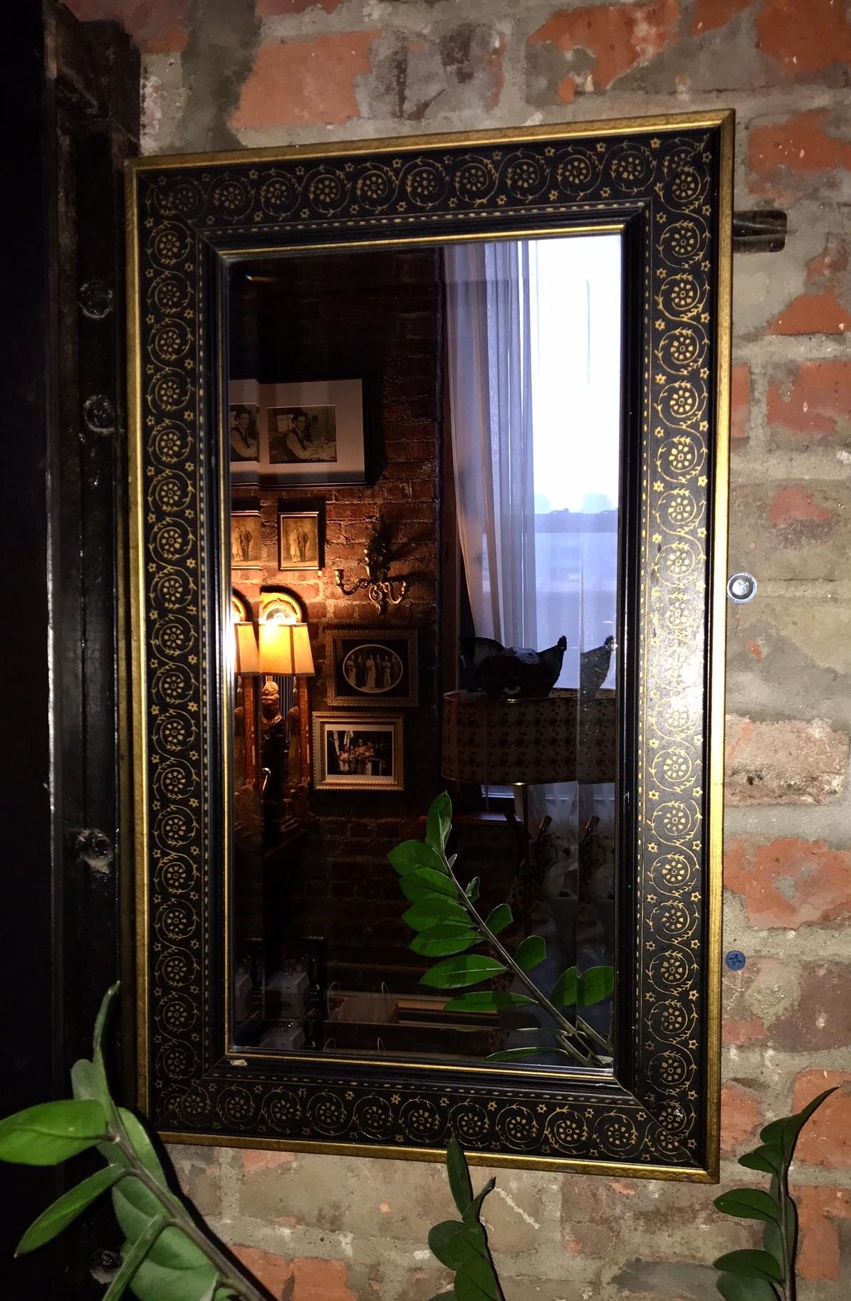 Ornate black & gold mirror $85