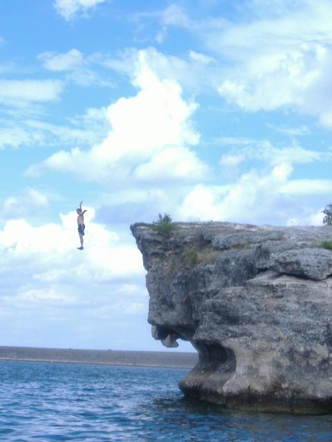 Robert jumping off a cliff