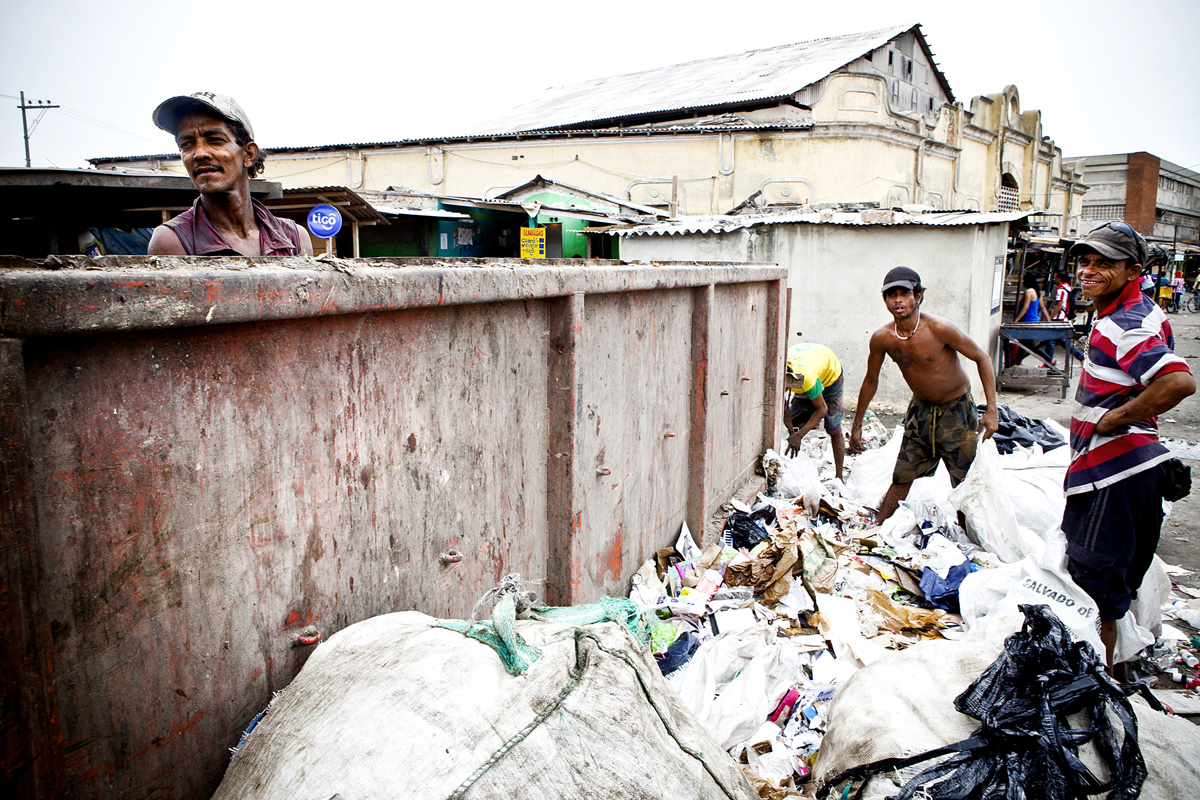 Men working together to sort trash in Barranquilla, Colombia 2014.